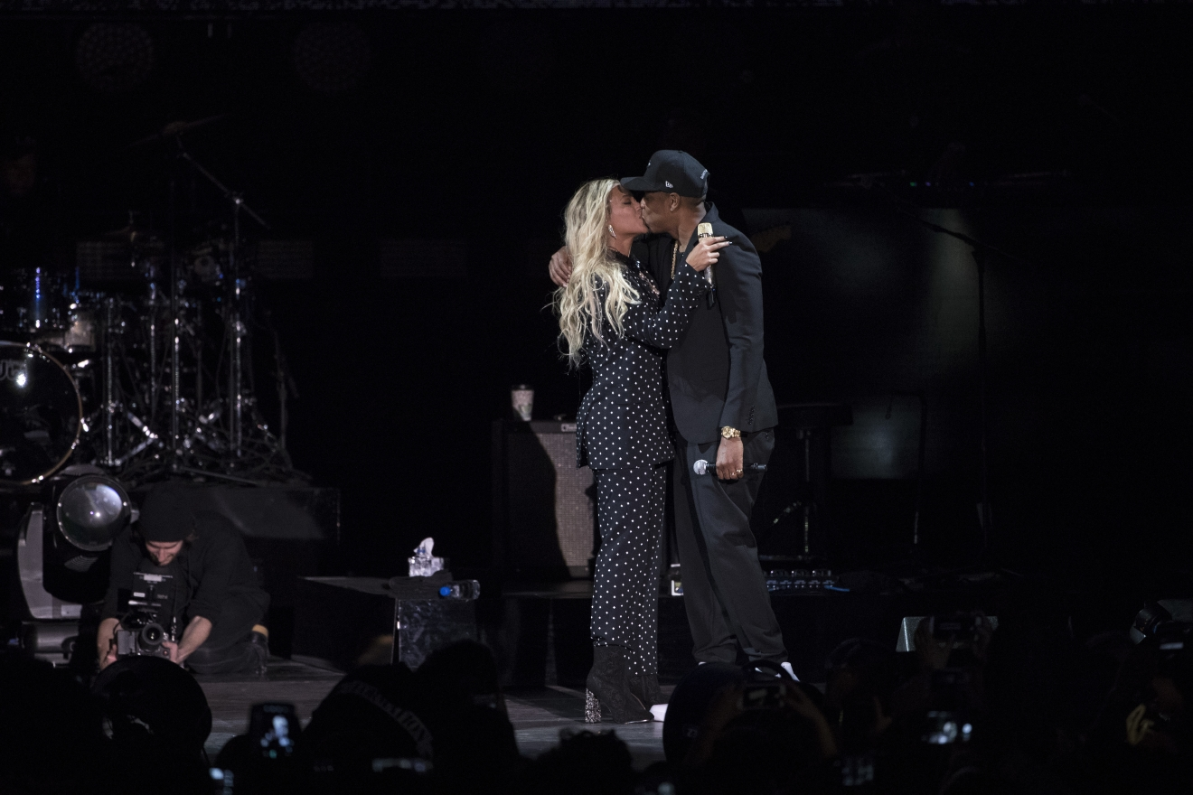 Jay Z and Beyonce embrace during a campaign rally for Democratic presidential candidate, Hillary Clinton, in Cleveland, Friday, Nov. 4, 2016. Clinton's campaign is turning to a series of star-studded free concerts in swing states to try and energize young and minority voters. (AP Photo/Matt Rourke)