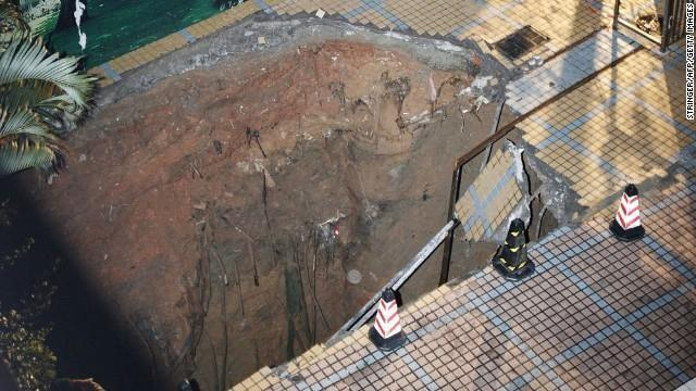 A sinkhole killed a guard in a construction site in Shenzhen, in China's Guangdong province, on Wednesday, March 27.