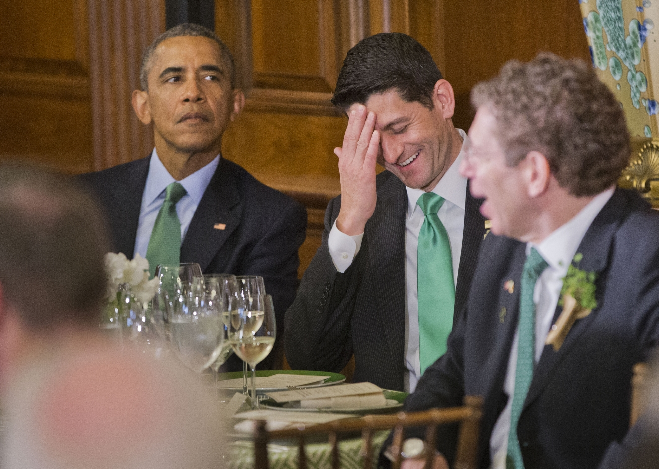 President Barack Obama, left, and House Speaker Paul Ryan of Wis., right, listen to Irish Prime Minister Enda Kenny, speak during a lunch celebrating St. Patrick's Day on Capitol Hill in Washington, Tuesday, March 15, 2016. (AP Photo/Pablo Martinez Monsivais)
