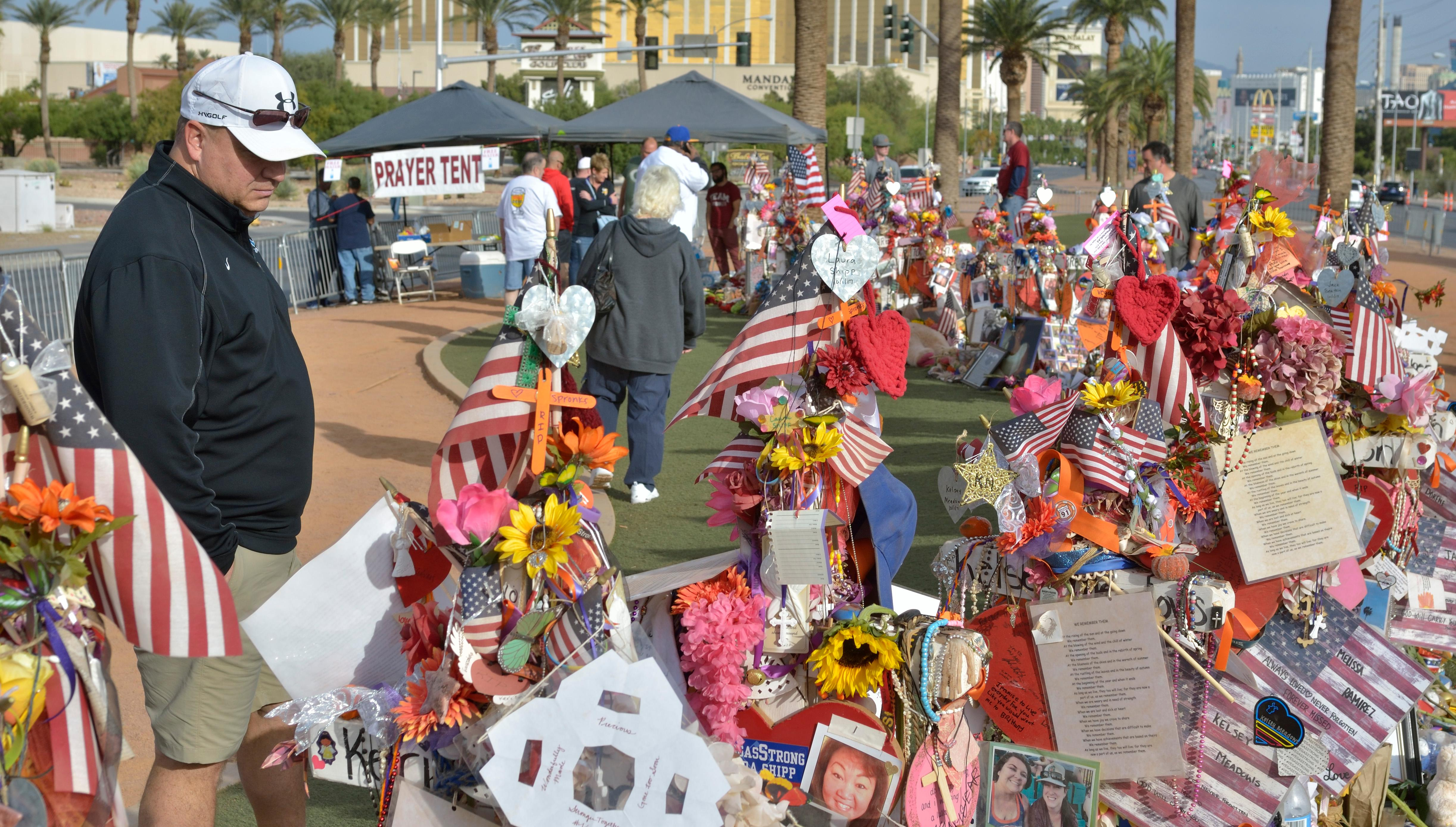 "Part of a memorial is shown during ""Greg Zanis Day"" at the Welcome to Fabulous Las Vegas sign on the Las Vegas Strip on Sunday, Nov. 12, 2017. Zanis, a carpenter from Aurora, Ill., was recognized by the Clark County Commision for creating 58 crosses memorializing those who died during the Route 91 Harvest festival shooting on Oct. 1. The crosses were later moved to the Clark County Museum for its permanent collection. [Bill Hughes/Las Vegas News Bureau]"