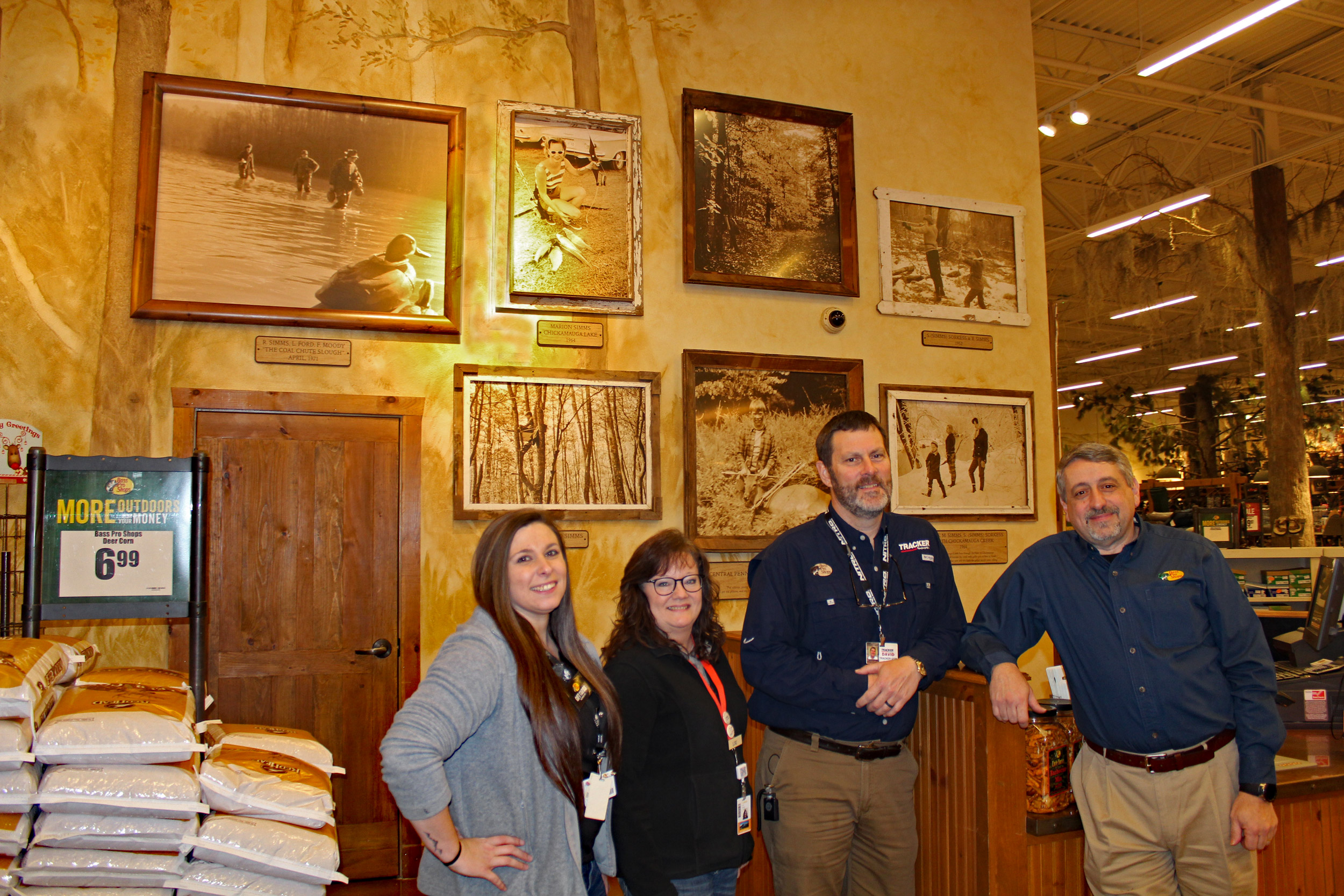 "East Ridge Bass Pro managers at the new ""Simms Wall of Fame."" (l-r) Events Coordinator Amy Dodson, Events Coordinator Lori Gilley, Tracker Boats Manager David Hickman and East Ridge Bass Pro General Manager Robert Lionetti. (Photo: Richard Simms)"