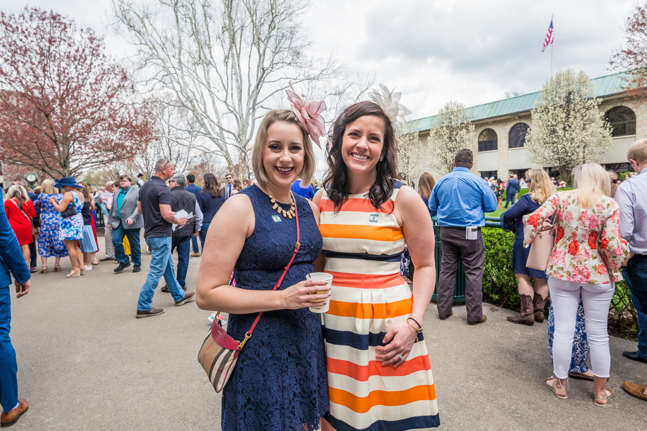 Attendees Jessica Haldeman and Kelsey Knapp enjoy a drink in the paddock area at Keeneland. / Image courtesy of Catherine Viox // Published:{ }4.12.19