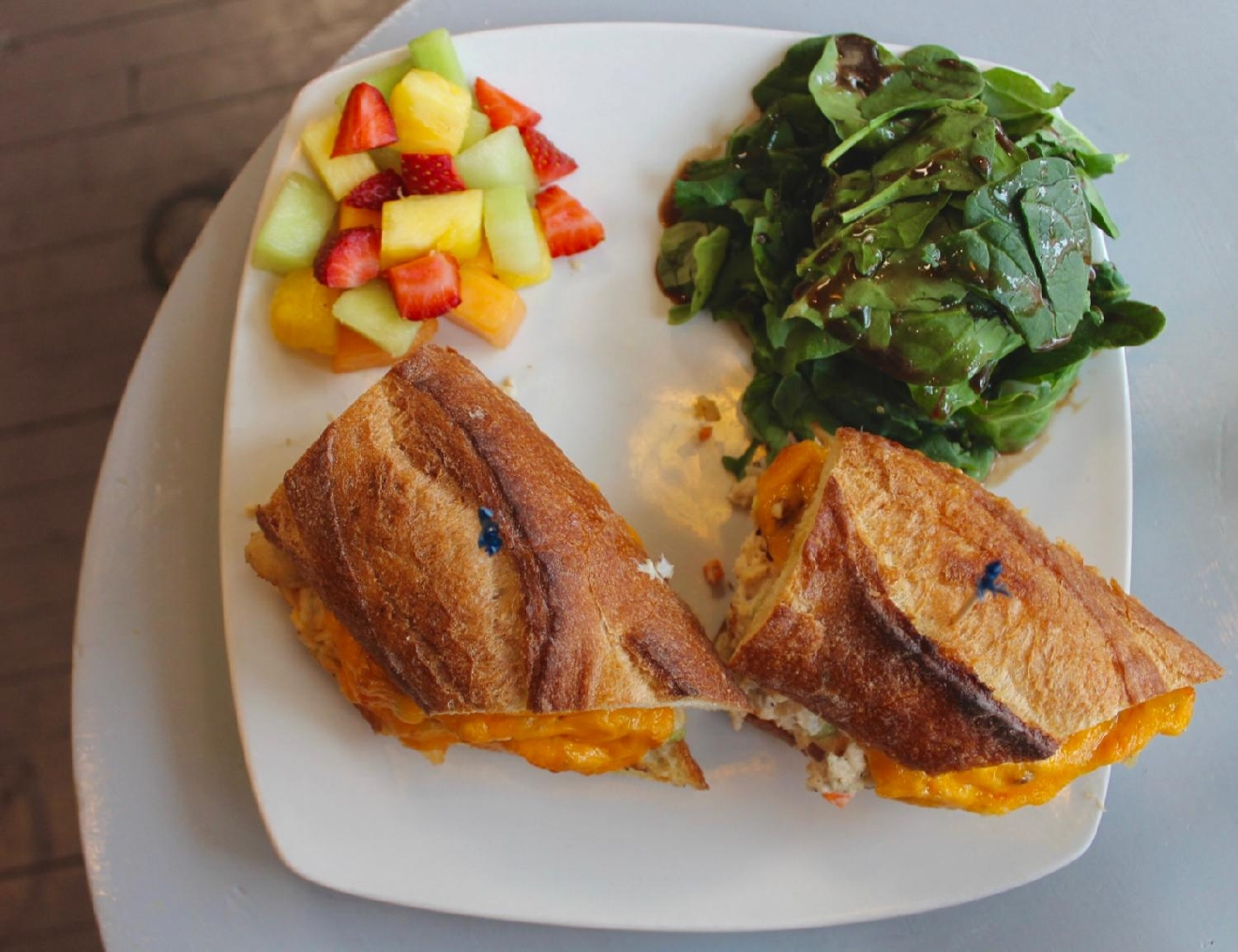Tuna melt: wild tuna, olive tapenade, and roasted red peppers on a French baguette served with fresh fruit and mixed greens / Image: Rose Brewington // Published: 3.24.17