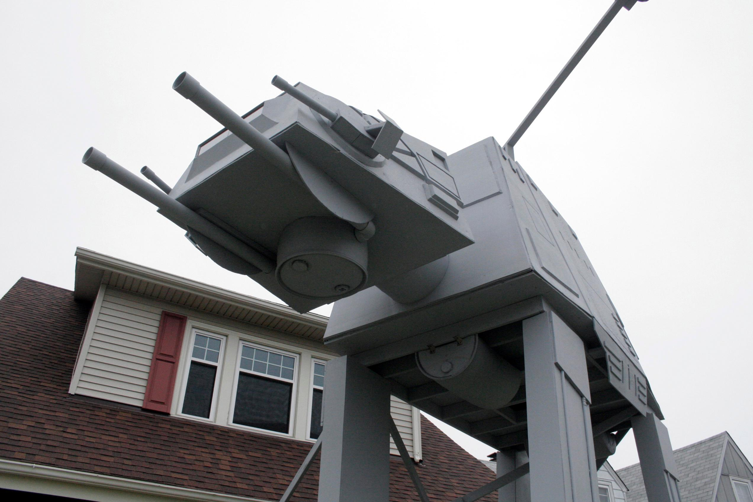 "This Thursday, Oct. 12, 2017 photo shows a replica four-legged All Terrain Armored Transport, or AT-AT walker in Parma, Ohio. Owner Nick Meyer tells Cleveland.com he used wood, hard foam and plastic barrels. He says he enjoys the ""Star Wars"" movies but isn't a fanatic and simply thought the display would be unique. (Patrick Cooley/The Plain Dealer-Cleveland.com via AP)"