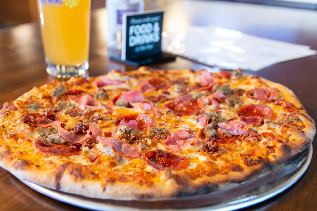 Meat Lover's Pizza: a blend of red sauce, house cheese blend, bacon, Italian sausage, pepperoni, and spicy capicola brick oven-baked / Image: Elizabeth A. Lowry{ }// Published: 7.20.20