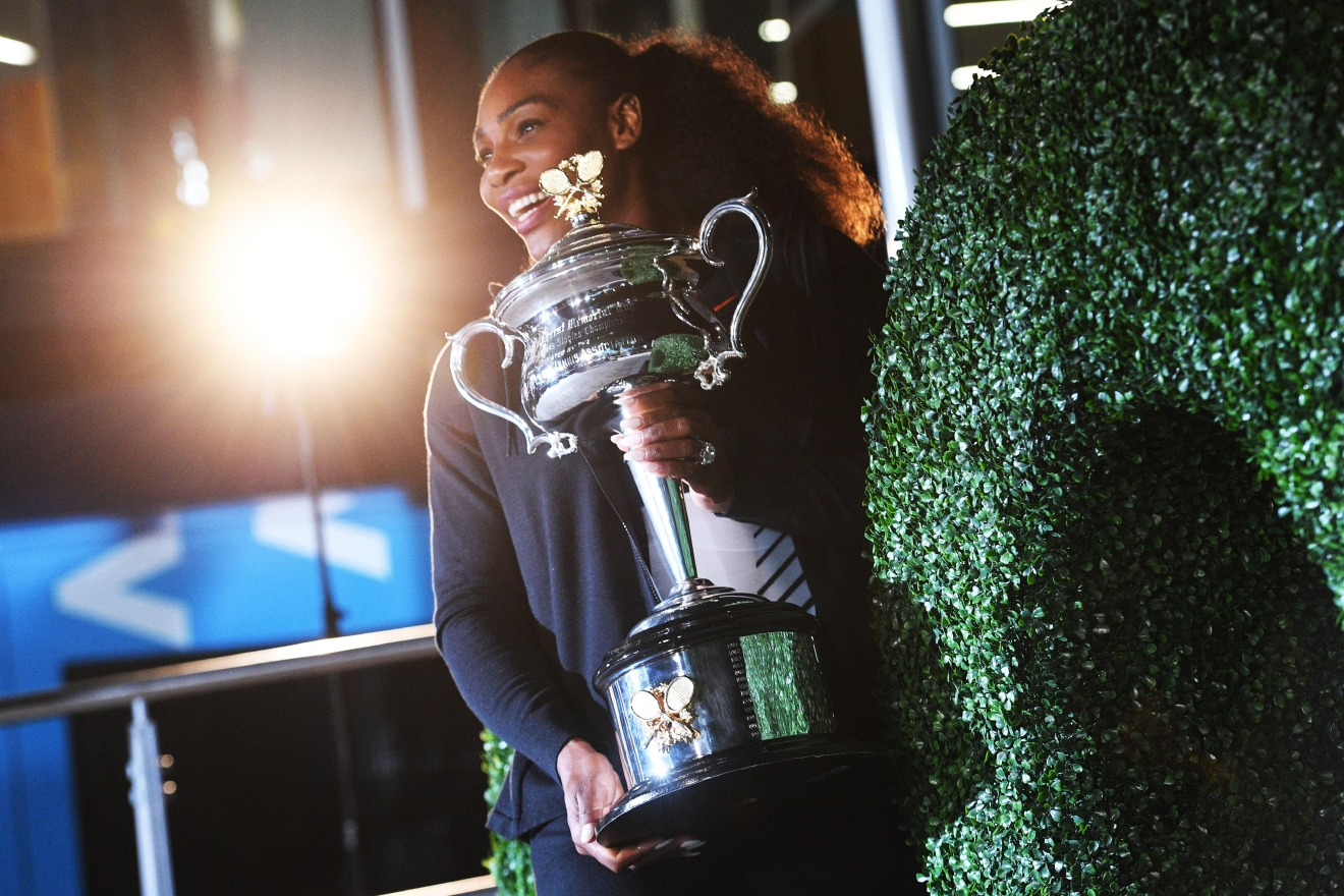 Serena Williams of the US poses with the championship trophy after her victory against Venus Williams of the US in the women's singles final on day 13 of the Australian Open tennis tournament in Melbourne on January 29, 2017. / AFP / WILLIAM WEST / IMAGE RESTRICTED TO EDITORIAL USE - STRICTLY NO COMMERCIAL USE        (Photo credit should read WILLIAM WEST/AFP/Getty Images)