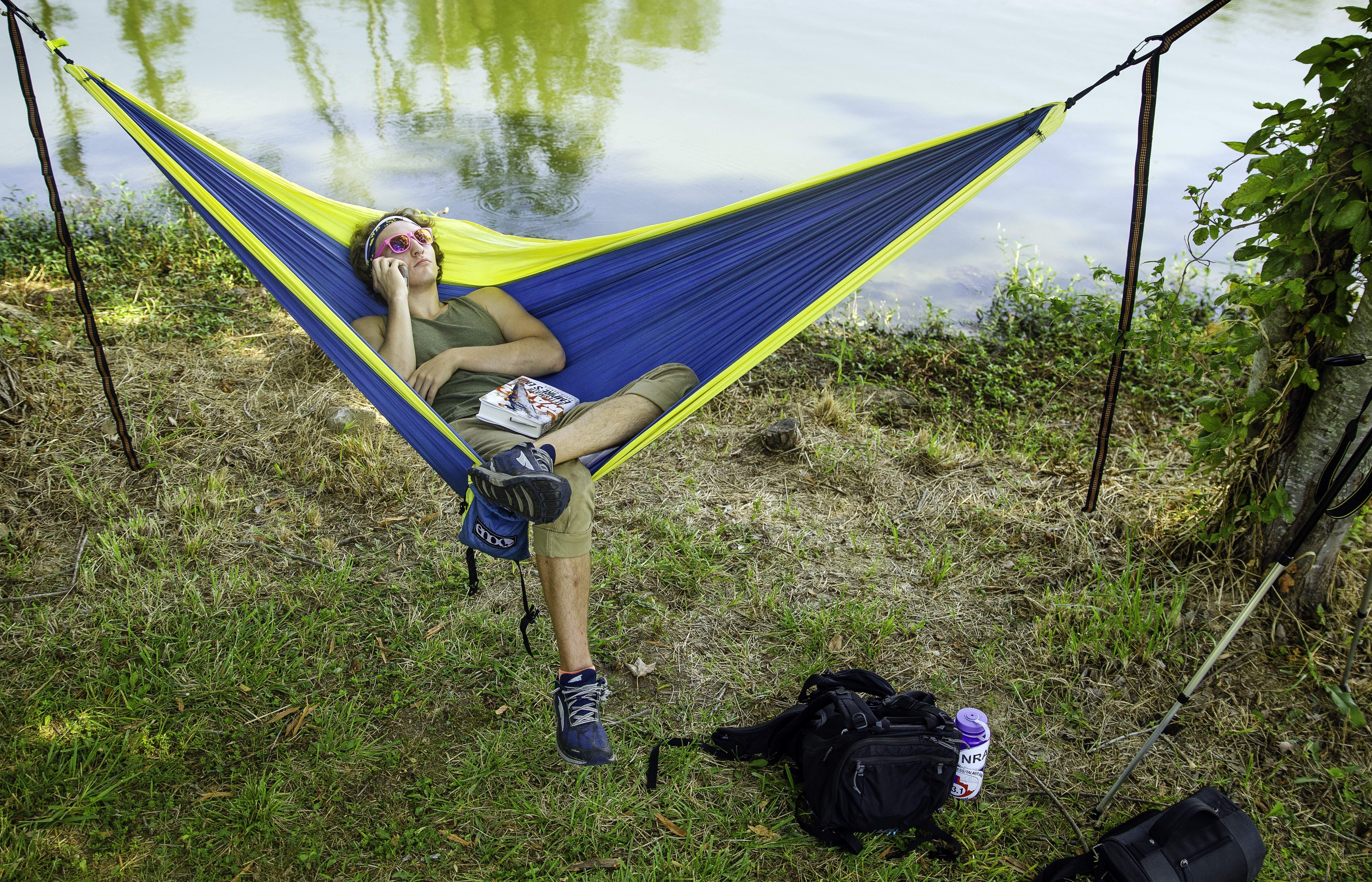 Christopher Rockwell of Battle Creek, MI, waits in his hammock for the total solar eclipse at Evergreen Park in Carbondale, Ill. Monday, Aug. 21, 2017. Rockwell ended up sleeping in his car last night after arriving after dark and deciding that hunting around the national park that late wasn't a good idea. [Ted Schurter/The State Journal-Register]