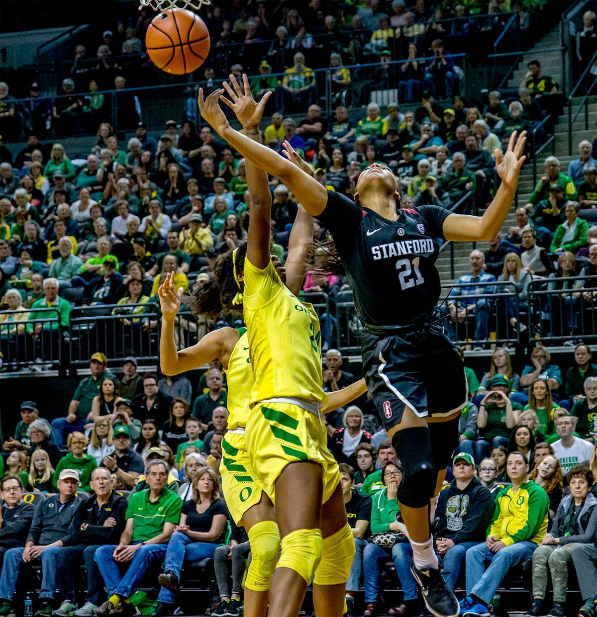 The Cardinal's DiJonai Carrington (#21) goes up as she attempts to make the basket. The Stanford Cardinal defeated the Oregon Ducks 78-65 on Sunday afternoon at Matthew Knight Arena. Stanford is now 10-2 in conference play and with this loss the Ducks drop to 10-2. Leading the Stanford Cardinal was Brittany McPhee with 33 points, Alanna Smith with 14 points, and Kiana Williams with 14 points. For the Ducks Sabrina Ionescu led with 22 points, Ruthy Hebard added 16 points, and Satou Sabally put in 14 points. Photo by August Frank, Oregon News Lab