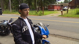 Fishing line strung across road cuts neck of motorcycle rider
