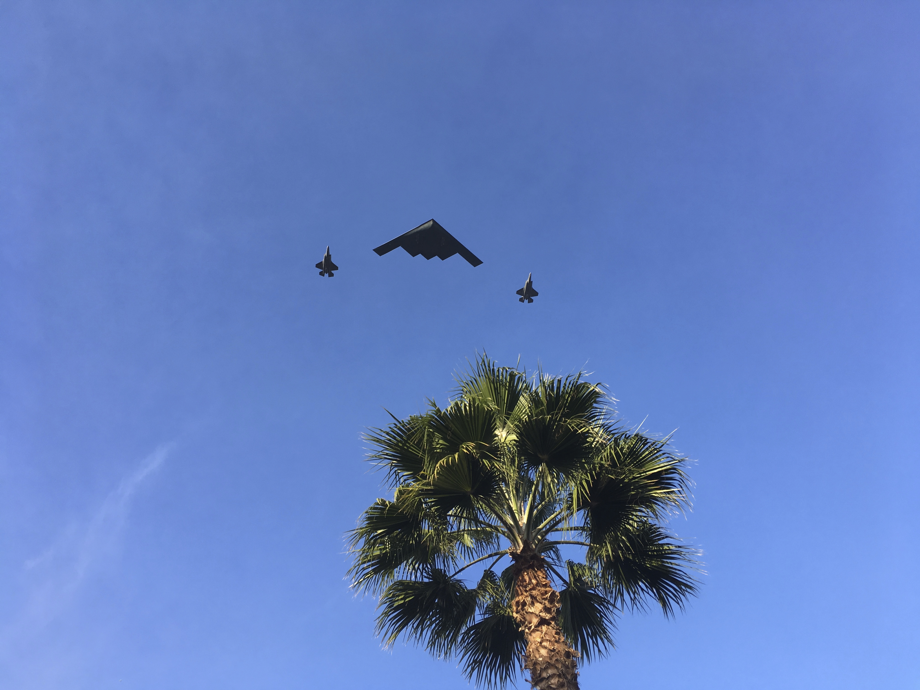 "A B-2 Spirit, also known as the Stealth Bomber, and two fighters jets fly over the 2018 Rose Parade route in Pasadena, Calif., Monday, Jan. 1, 2018. The 129th annual parade got started Monday in Pasadena with an announcement by the grand marshal, actor Gary Sinise, and a military flyover. The theme of the 2018 parade is ""Making a Difference"" and Sinise was chosen to lead the proceedings because of his devotion to veteran's issues. (AP Photo/John Antczak)"