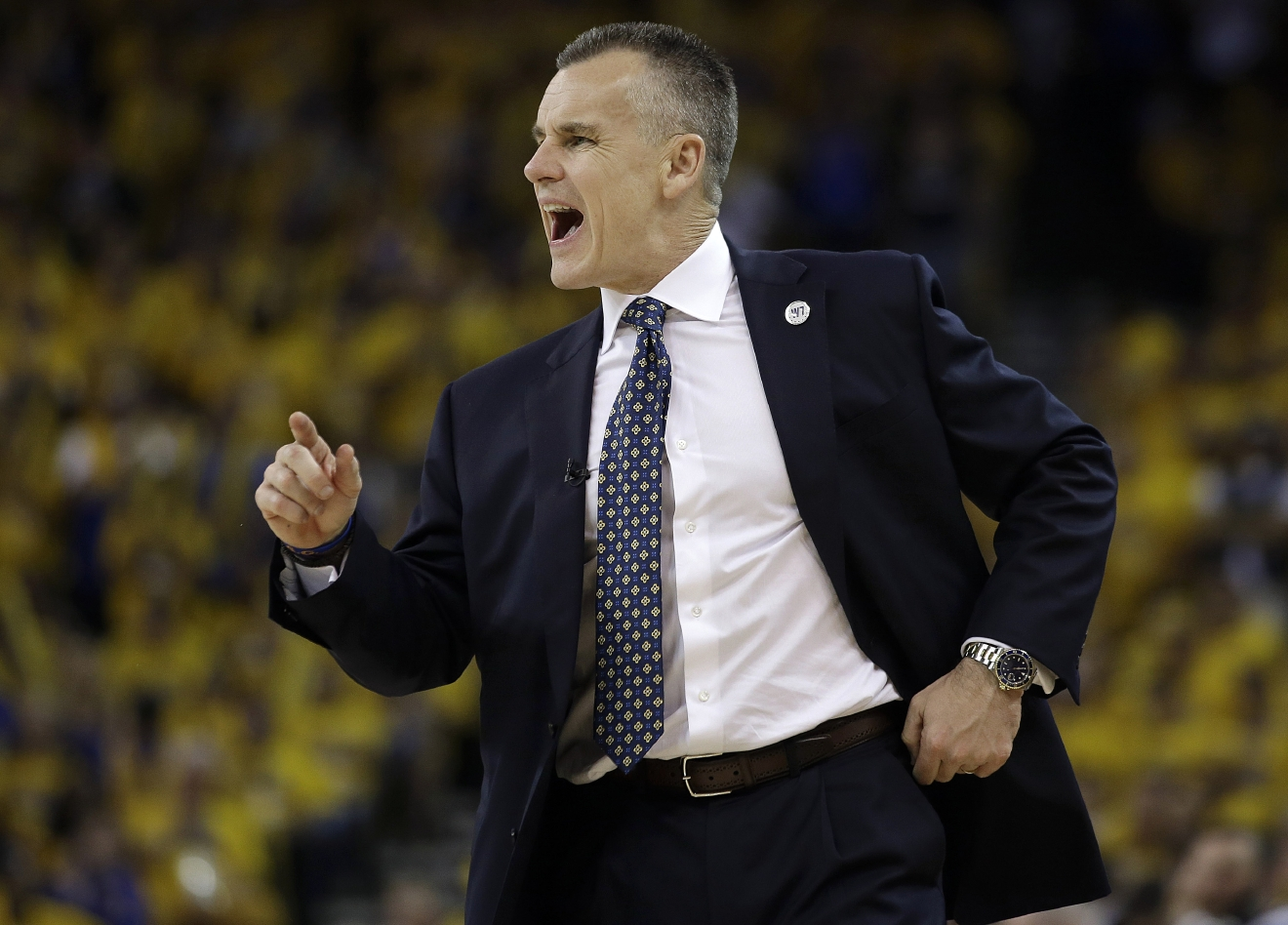 FILE - In this May 18, 2016, file photo, Oklahoma City Thunder head coach Billy Donovan yells during the second half of Game 2 of the NBA basketball Western Conference finals against the Golden State Warriors in Oakland, Calif. Donovan is trying to lead the Thunder to a championship as a first-year NBA coach, just as Steve Kerr did with Golden State last year. Friends off the court, their teams are 1-1 in the Western Conference finals that resume Sunday night at Oklahoma City.  (AP Photo/Marcio Jose Sanchez, File)
