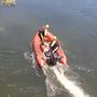 Two rescued from dangerous waters by swift water rescue crews