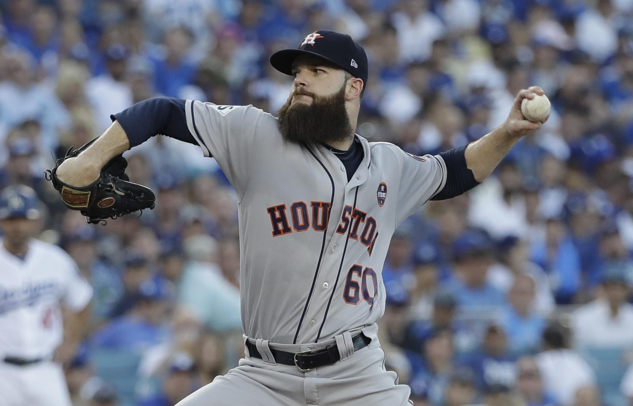 Houston Astros starting pitcher Dallas Keuchel throws during the first inning of Game 1 of baseball's World Series against the Los Angeles Dodgers Tuesday, Oct. 24, 2017, in Los Angeles. (AP Photo/David J. Phillip)