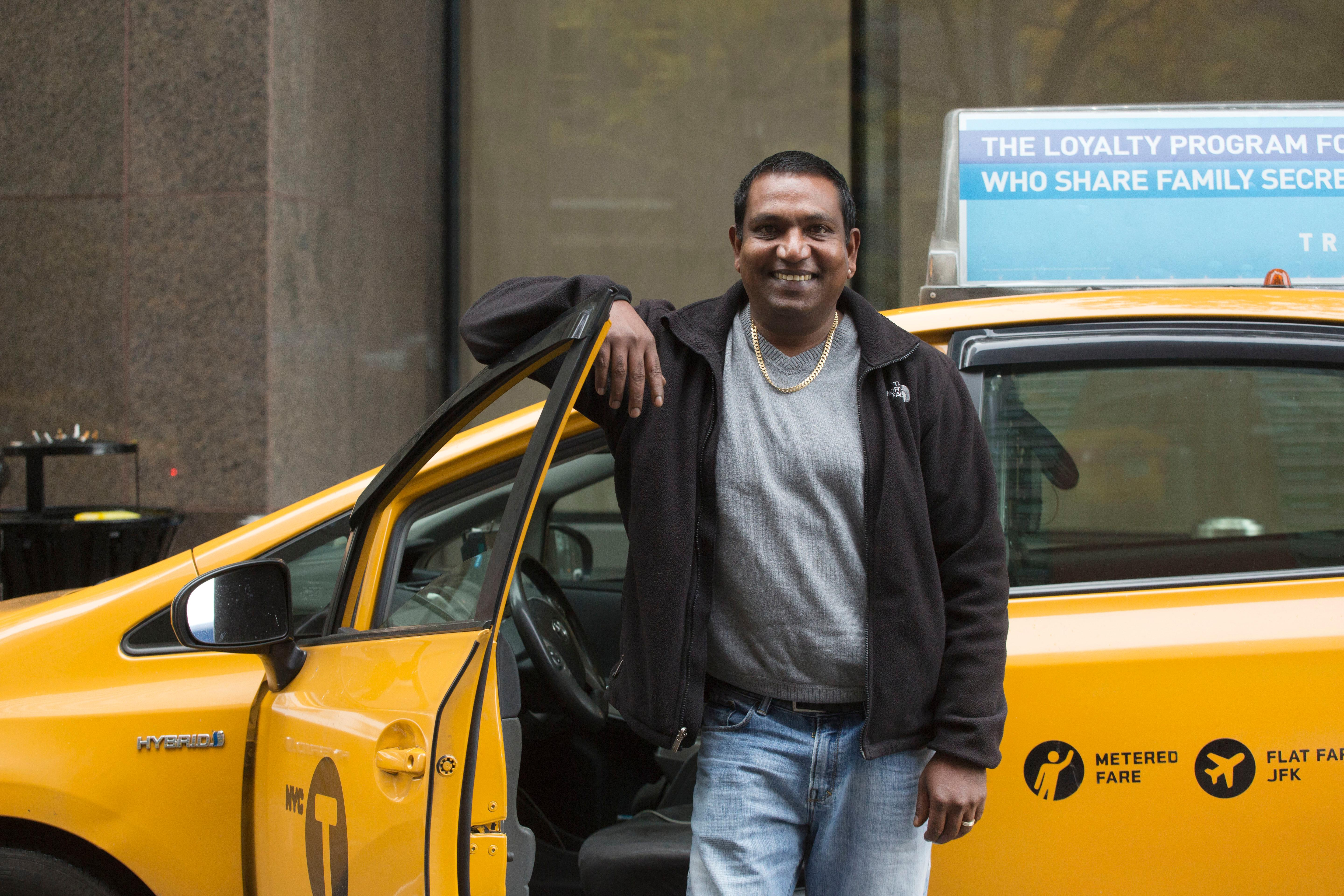 Taxi driver Terry Samlall poses for a portrait, Thursday, Nov. 16, 2017 in New York. Smalall is featured as Mr. November in the 2018 NYC Taxi Drivers calendar. The NYC Taxi Drivers Calendar has twelve New York City cabbies smirking and smoldering their way through 2018 in a tongue-in-cheek pinup calendar that's raising money for a venerable social-service organization. (AP Photo/Mark Lennihan)