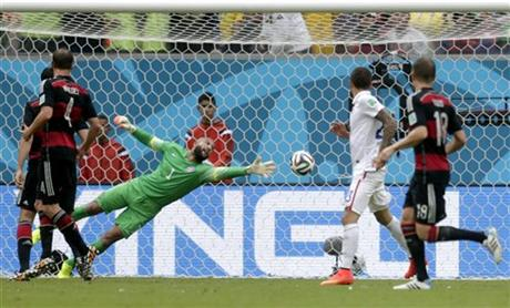 United States' goalkeeper Tim Howard can not stop a shot by Germany's Thomas Mueller to score his side's first goal during the group G World Cup soccer match between the United States and Germany at the Arena Pernambuco in Recife, Brazil.