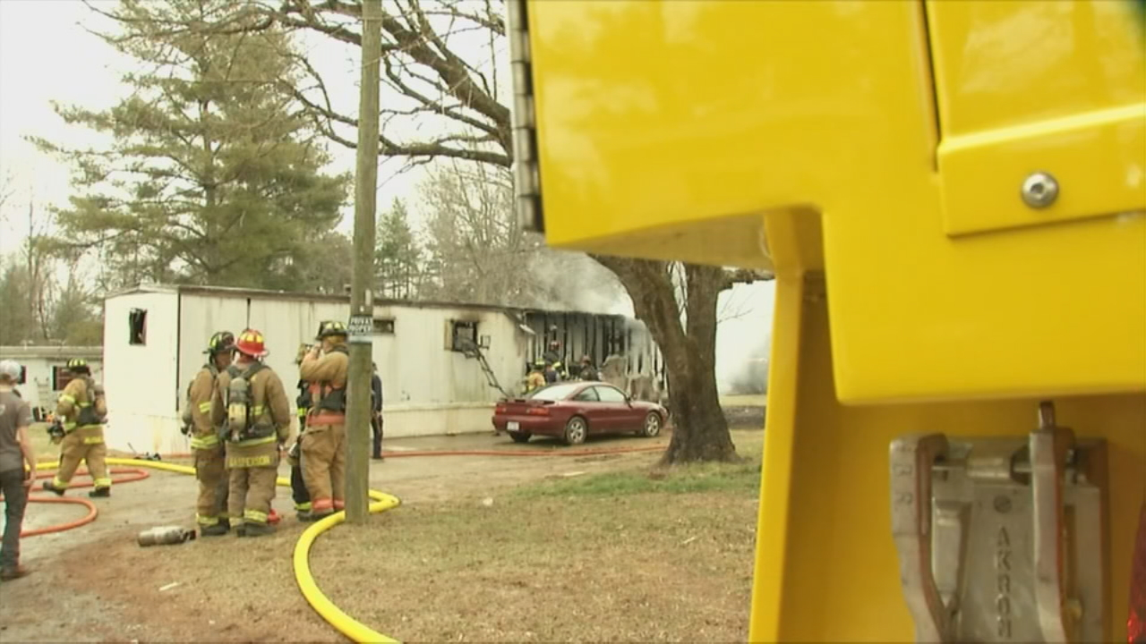 Six departments responded to a fire at a mobile home near downtown Hendersonville on Monday morning. (Photo credit: WLOS staff)