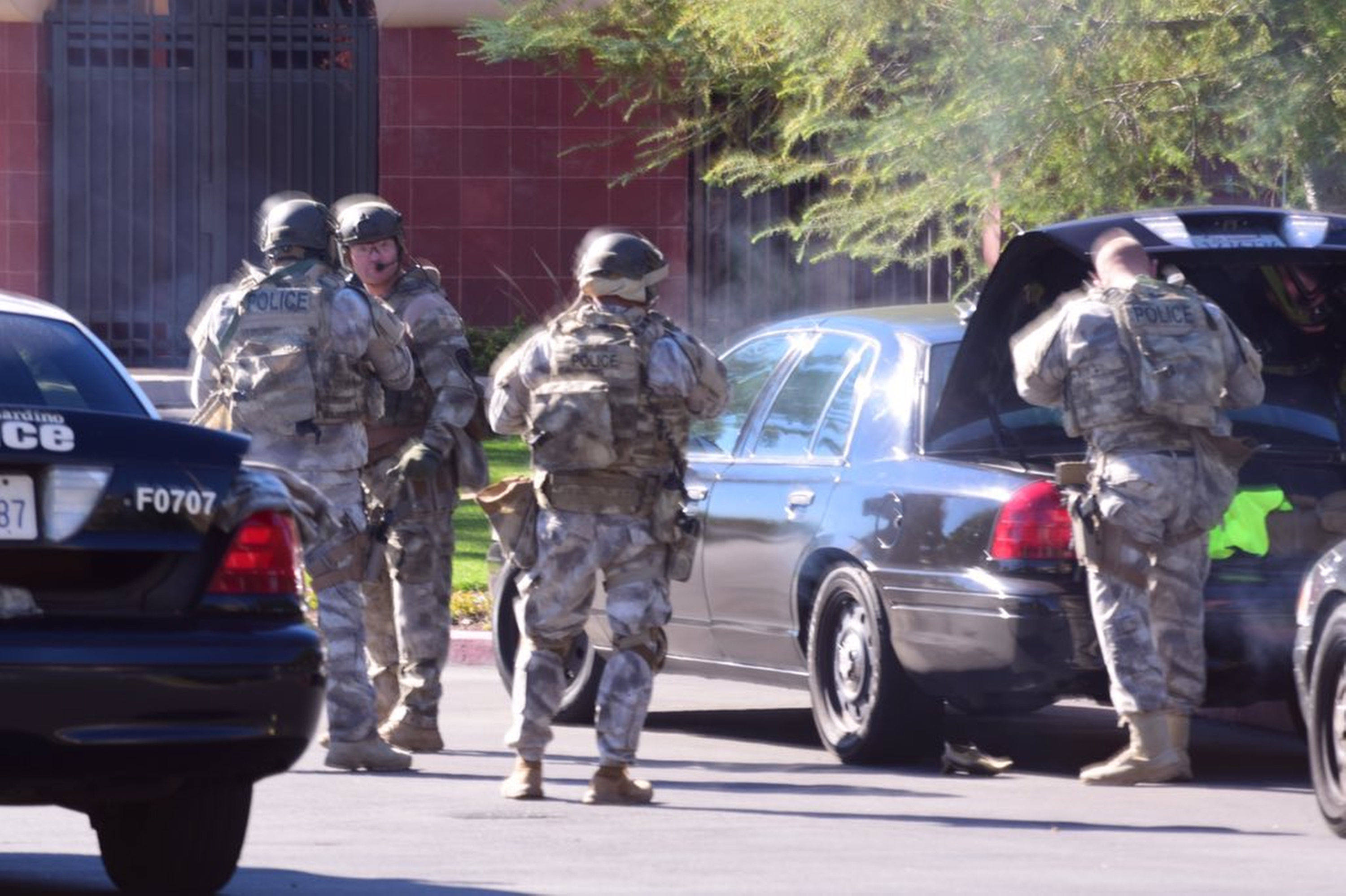 A swat team arrives at the scene of a shooting in San Bernardino, Calif. on Wednesday,  Dec. 2, 2015.  Police responded to reports of an active shooter at a social services facility. (Doug Saunders/Los Angeles News Group via AP)