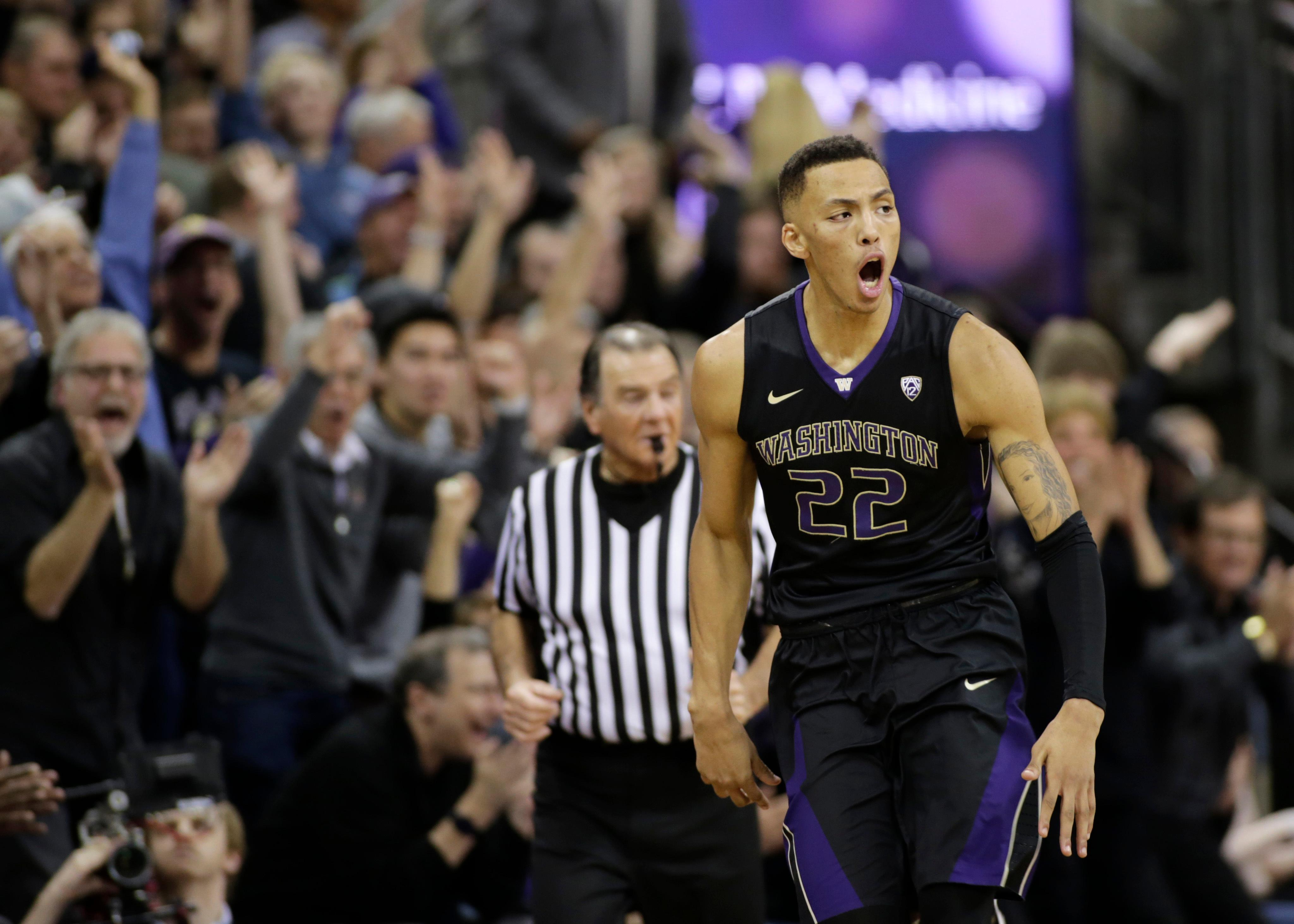 Washington's Dominic Green reacts after sinking a 3-point basket during the second half against Arizona in an NCAA college basketball game Saturday, Feb. 3, 2018, in Seattle. Washington won 78-75 with Green later hitting the tie-breaking shot in the final seconds. (AP Photo/John Froschauer)