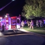 3 people, dog safe after heavy flames burn through metro home