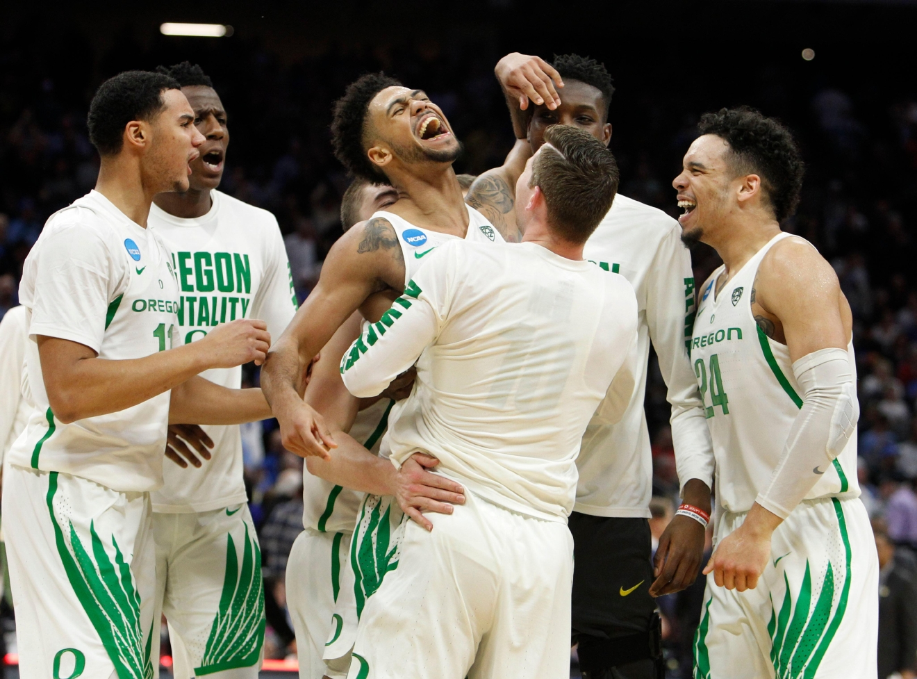 Oregon guard Tyler Dorsey, center, celebrates with teammates after their win over Rhode Island during a second-round game in the NCAA college basketball tournament in Sacramento, Calif., Sunday, March 19, 2017. Oregon won 75-72. (AP Photo/Steve Yeater)