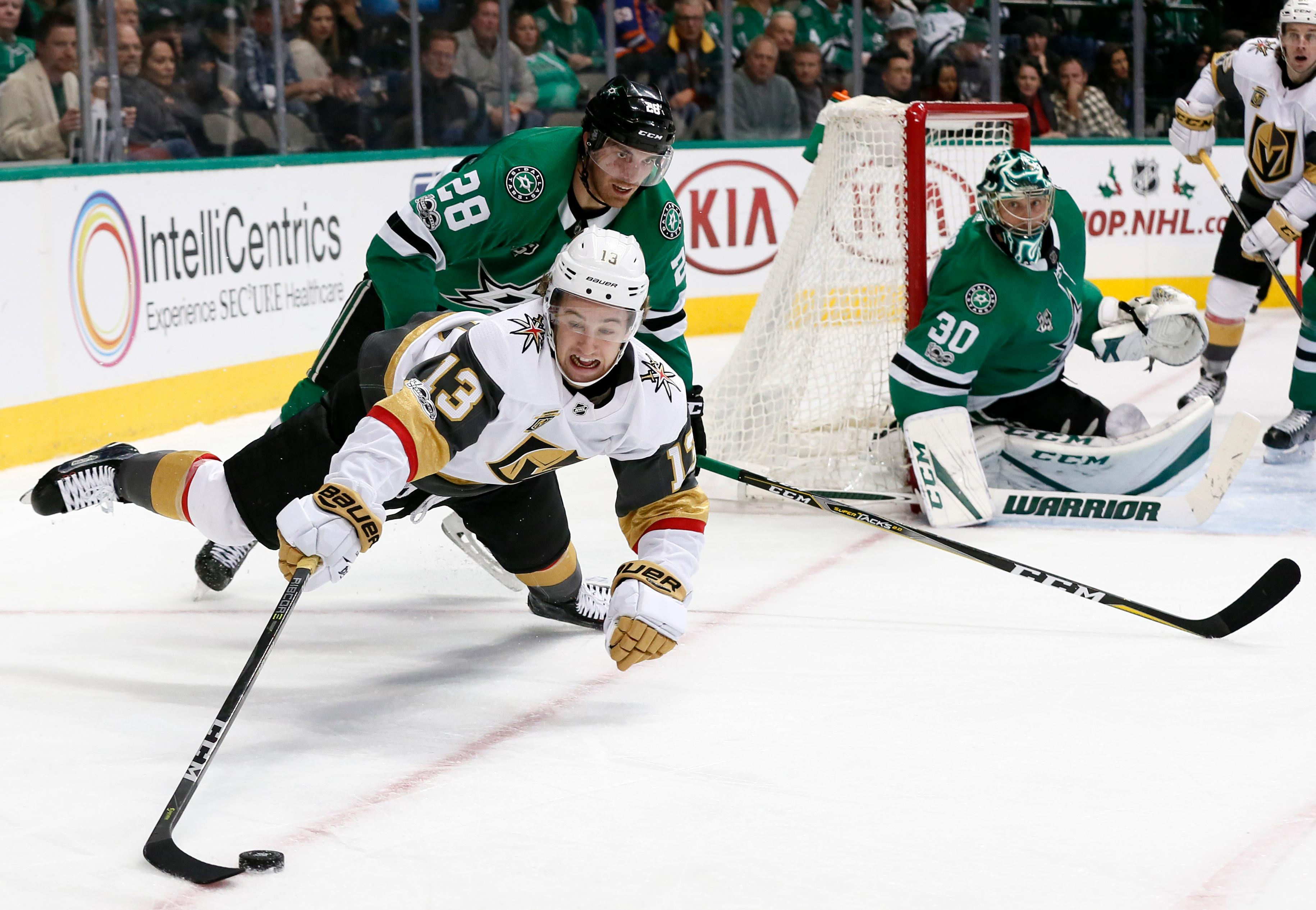 Vegas Golden Knights left wing Brendan Leipsic (13) falls while tyring to control the puck, after being tripped by Dallas Stars' Stephen Johns (28), as goalie Ben Bishop (30) watches during the second period of an NHL hockey game, Saturday, Dec. 9, 2017, in Dallas (AP Photo/Tony Gutierrez)