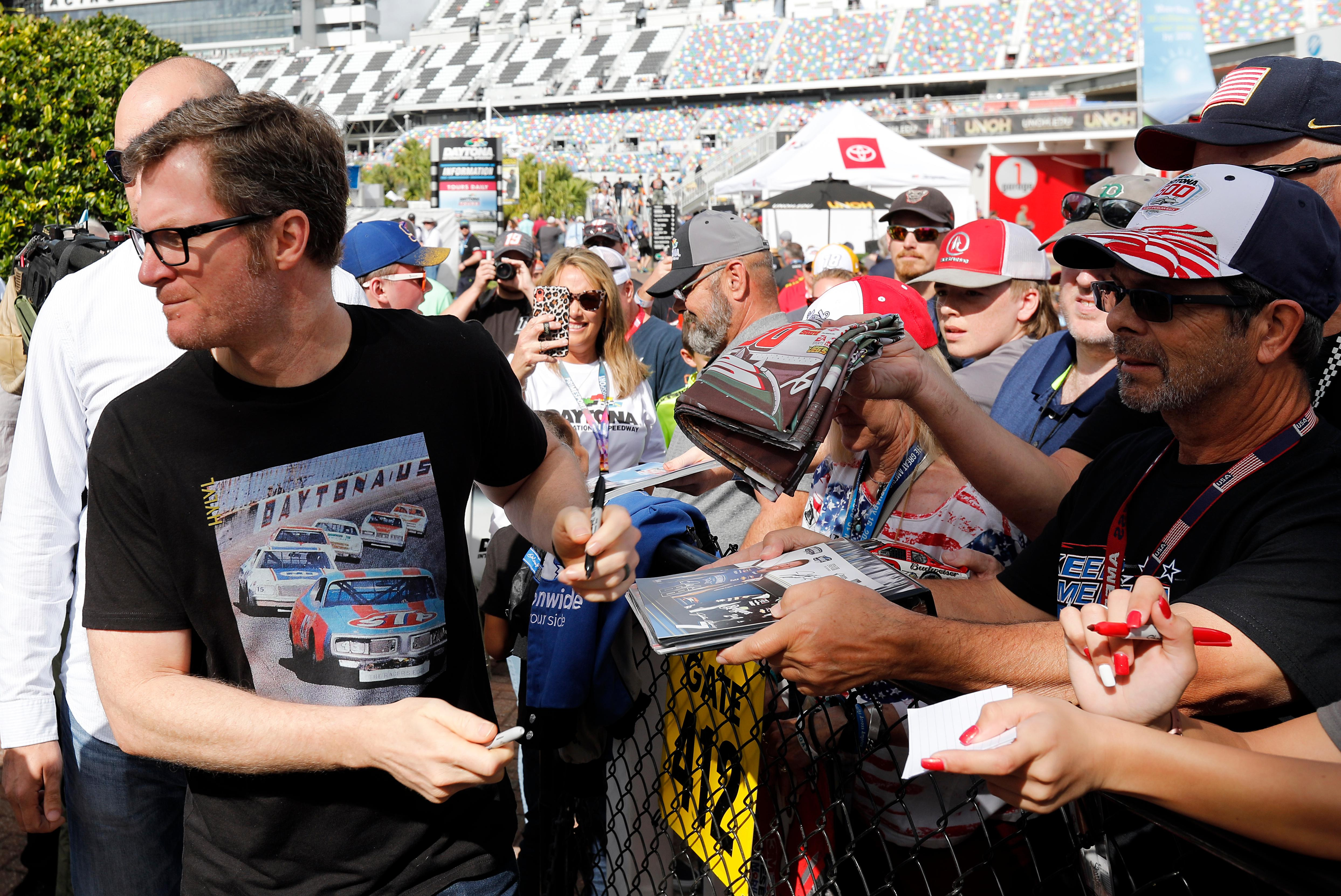 Dale Earnhardt Jr., team owner and TV analyst signs autographs outside the media center before the NASCAR Daytona 500 auto race at Daytona International Speedway, Sunday, Feb. 16, 2020, in Daytona Beach, Fla. (AP Photo/Terry Renna)