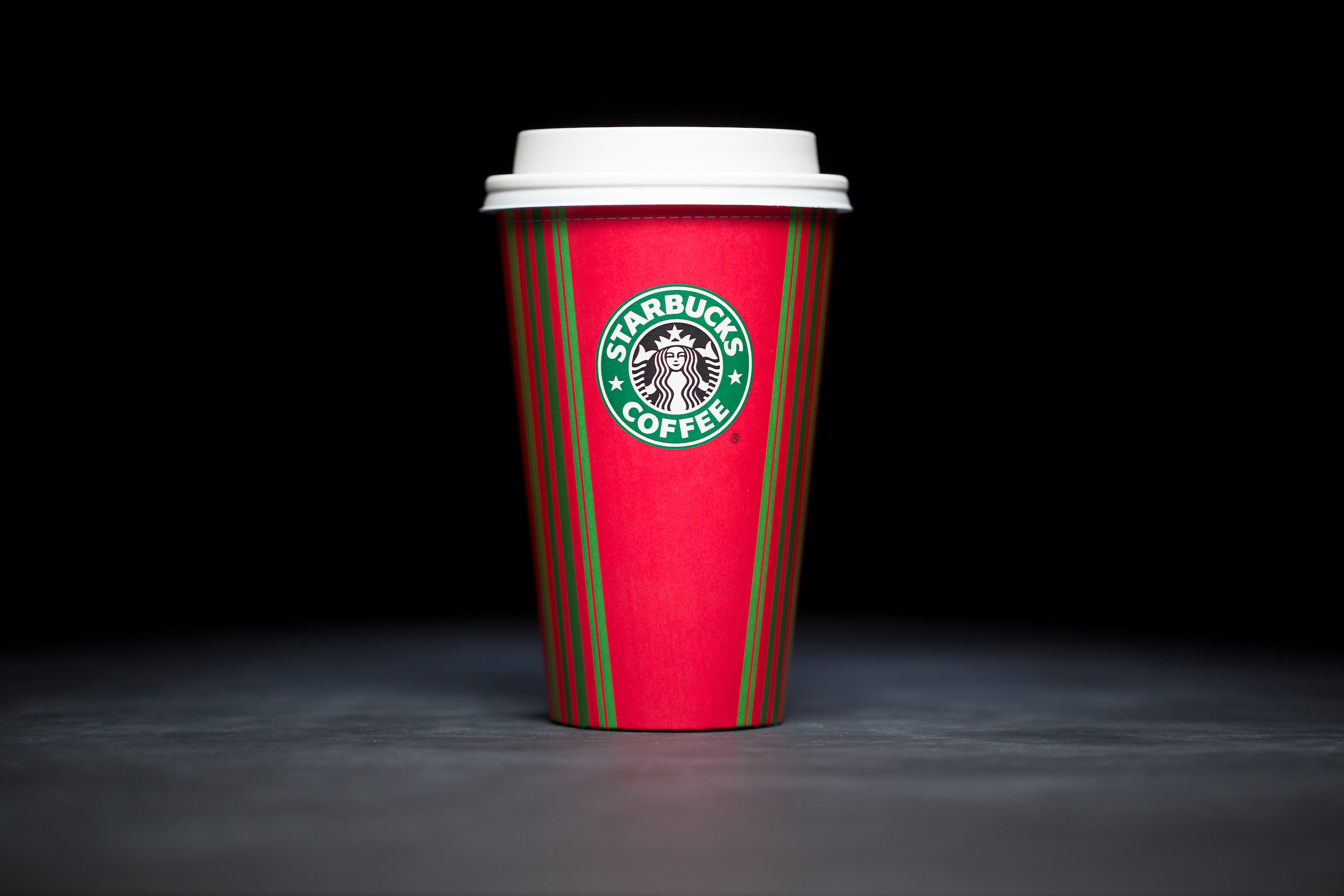 2001: For 20 years, Starbucks have released a range of holiday cup designs, most of them based around their world famous red cup. It's not easy to find the very first Starbucks holiday cups, which made their debut in stores in 1997. Few were saved, and electronic design files were lost in an earthquake in 2001. Even an Internet search is unyielding, with the cups having made their arrival long before the first selfie. But, we have them here! Click on for a photos of all 20 holidays cup designs. (Image: Joshua Trujillo/Cover Images)
