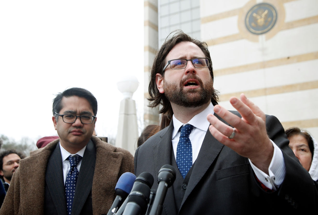 Justin Cox, right, of the National Immigration Law Center, representing the plaintiffs, accompanied  Omar Jadwat of the ACLU, speaks to reporters outside court in Greenbelt, Md., Wednesday, March 15, 2017. A federal judge in Maryland says he will issue a ruling in a lawsuit challenging President Donald Trump's revised travel ban. (AP Photo/Manuel Balce Ceneta)