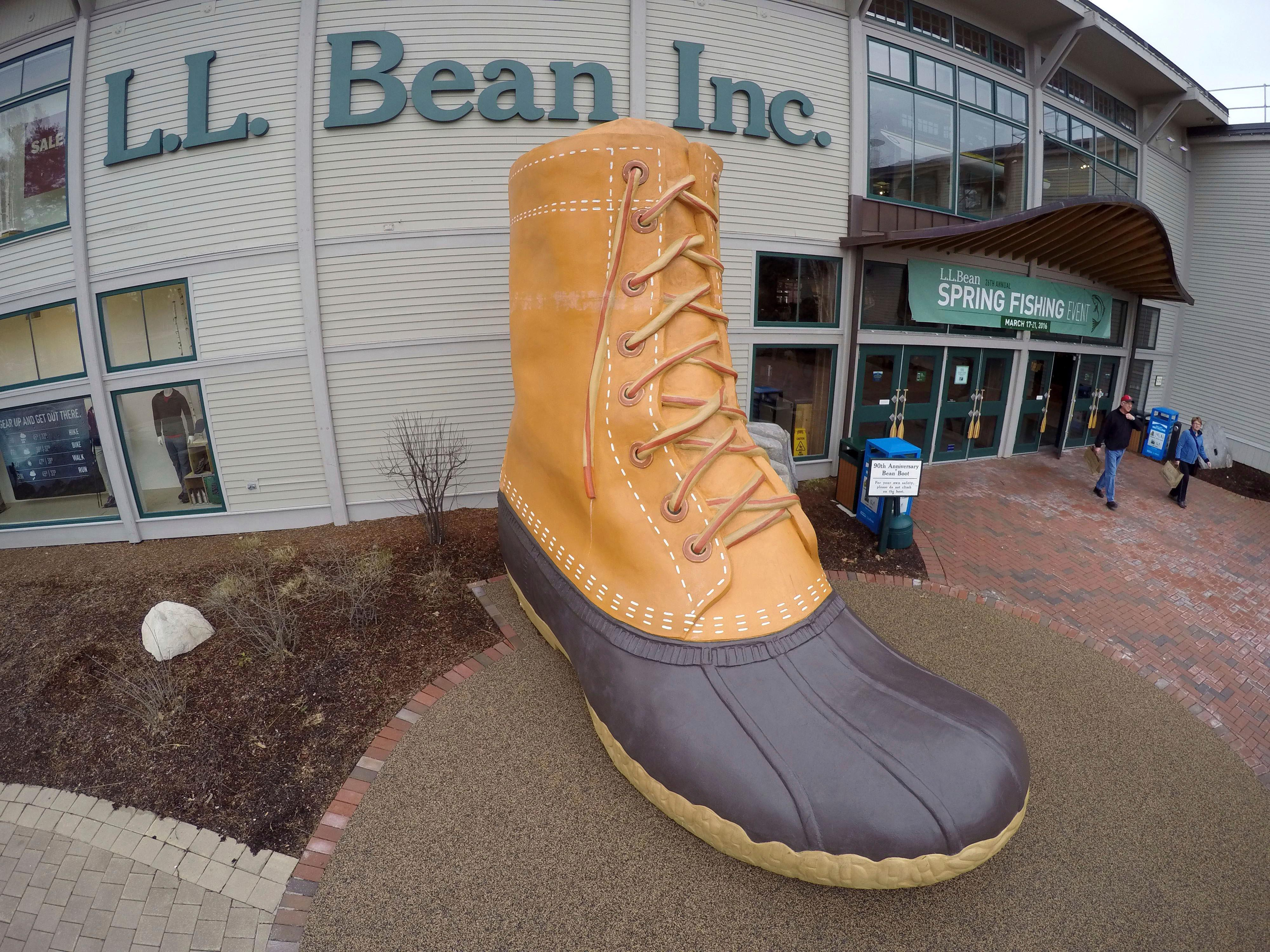 FILE - In this March 16, 2016, file photo, shoppers exit the L.L. Bean retail store in Freeport, Maine.   L.L. Bean is tightening its generous return policy by imposing a one-year limit on most returns to reduce abuse and fraud. Executives say returns of severely worn items have doubled over five years. Under the new policy announced Friday, Feb. 9, 2018, the company will accept returns for one year with a proof of purchase and will continue to replace products for manufacturing defects beyond that. (AP Photo/Robert F. Bukaty, File)