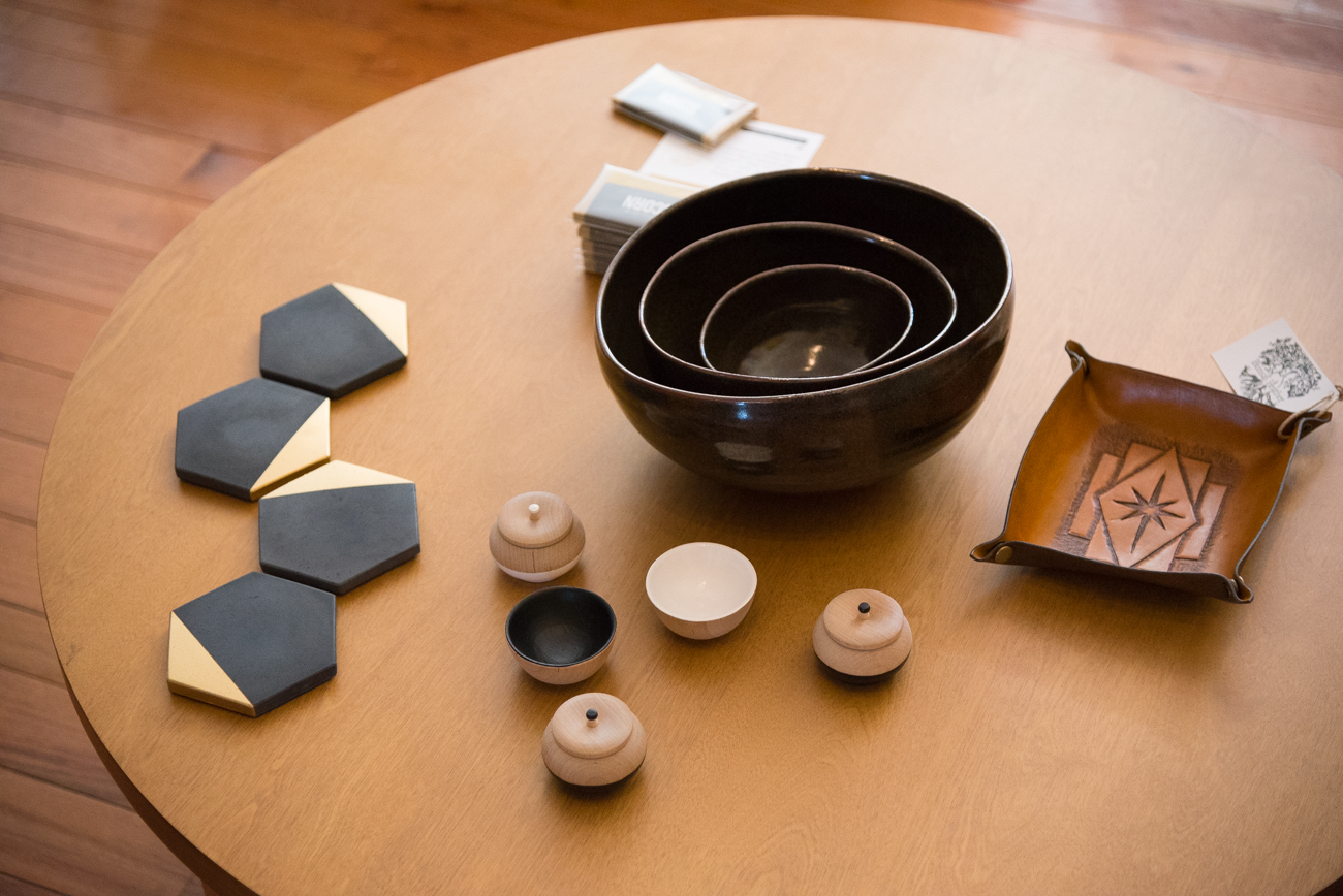 Gold-dipped cast concrete coasters by MeAConcrete, wooden jars and bowls by Paragraph Loop, ceramic nesting bowls by Ryan Van Hoy, and hand-tooled leather catch-alls by Bunsai Leather / Image: Phil Armstrong, Cincinnati Refined / Published: 11.12.16