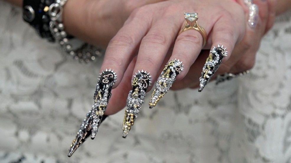 These nails are bedazzled in all kinds of metal jewelry | WVAH