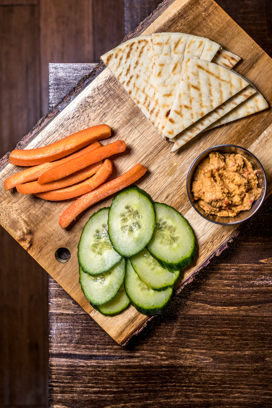 Red pepper hummus: homemade hummus, pita bread, carrots, and cucumbers / Image: Catherine Viox // Published: 7.18.20