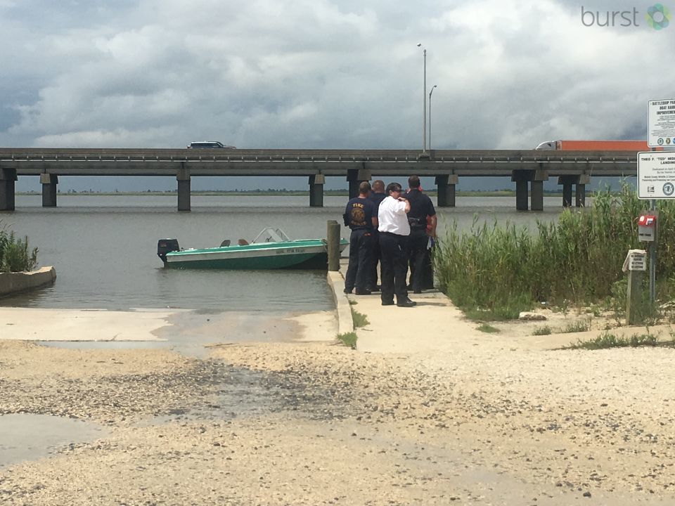 Sources on the scene say that three men were in a boat when it capsized. (WPMI)