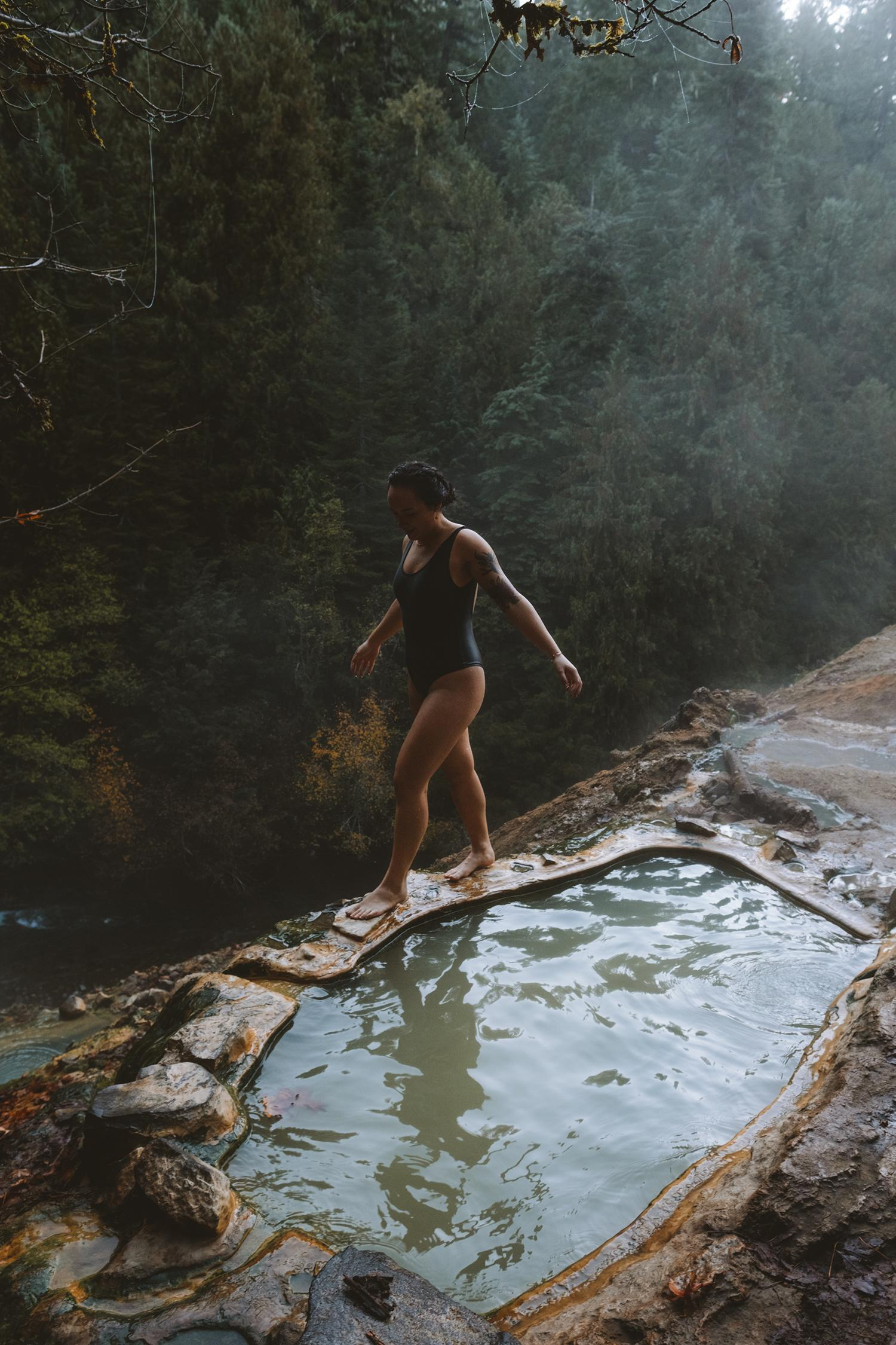 <p>Located in the central Oregon Cascades, Umpqua Hot Springs is accessible year-round and features a multitude of hot pools (and one covered) located on a mineral deposit above the North Umpqua River. Only a 1/4 mile hike from the parking area, and on a first come first serve basis, this hot spring is sure to please visitors. Beat the crowds by coming early in the morning for sunrise, and make sure to pack out any waste! While you're at it, you might as well make a stop at Toketee Falls as well! Located roughly 10 minutes from the springs, this incredibly short hike requires very little effort for a huge reward of a gorgeous cascading waterfall. (Image: Ryan McBoyle / Seattle Refined)</p>
