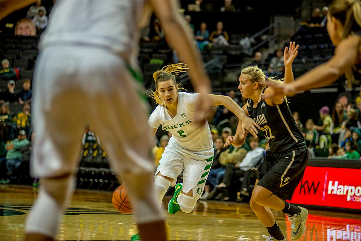 The Duck's Morgan Yaeger (#2) looks for an opening as she dribbles the ball down court. The UO Ducks Women's basketball team took the win against Idaho on Tuesday at Matthew Knight Arena, 73-70, in a game that saw the Ducks force a miss at the buzzer. Maite Cazorla (#5) achieved a double-double with 14 points and 10 assists. Lexi Bando (#10) added 17 points, and made 5 out of 6 three pointers. The Ducks are now 10-2 this season. Photos by August Frank, Oregon News Lab