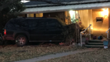 Police looking for suspect after vehicle crashes into a house