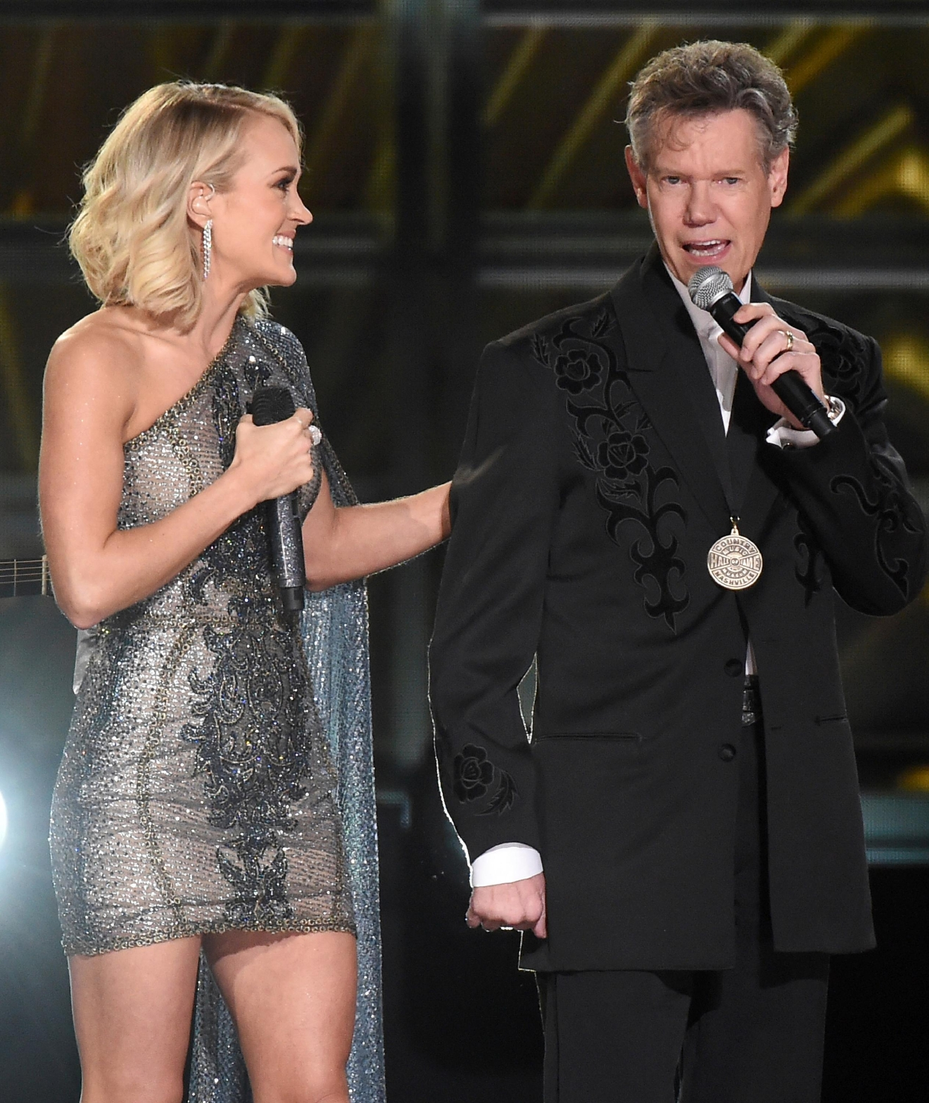 "Carrie Underwood, left, and Randy Travis perform ""Forever And Ever, Amen"" at the 50th annual CMA Awards at the Bridgestone Arena on Wednesday, Nov. 2, 2016, in Nashville, Tenn. (Photo by Charles Sykes/Invision/AP)"