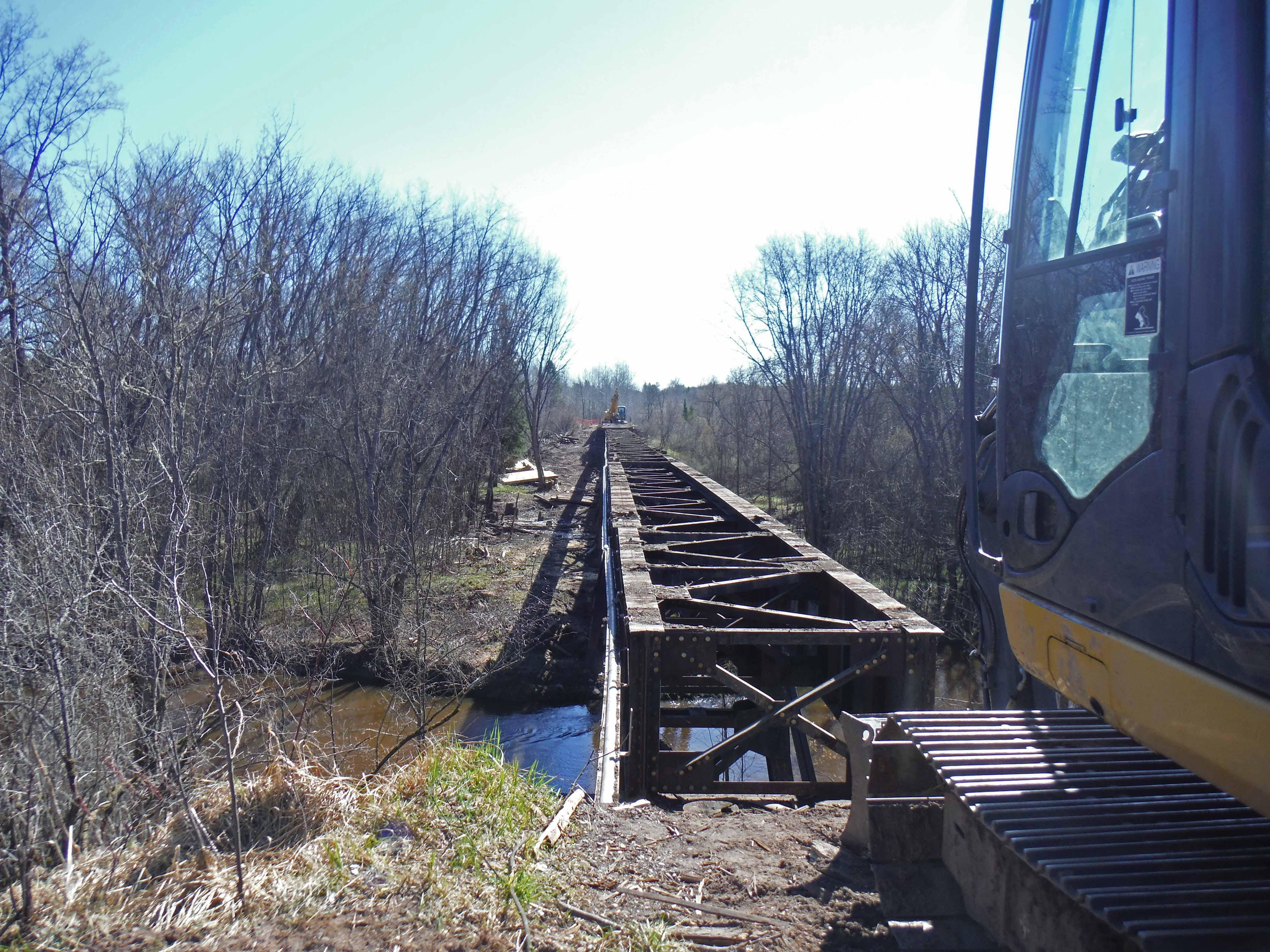 The decking and abutments of a trail bridge over the South Branch of the Ontonagon River are being removed.Credit: Michigan Department of Natural Resources.