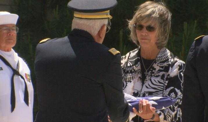Potter County Judge Nancy Tanner receives the flag used to honor the veterans.  (By:   Steve Douglass, KVII)