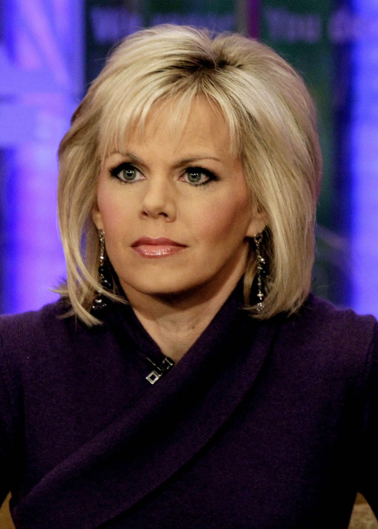 "FILE - This Nov. 30, 2010 file photo shows Gretchen Carlson, co-host of the ""Fox & friends"" television program appears on the show in New York.  (AP Photo/Richard Drew, file)"