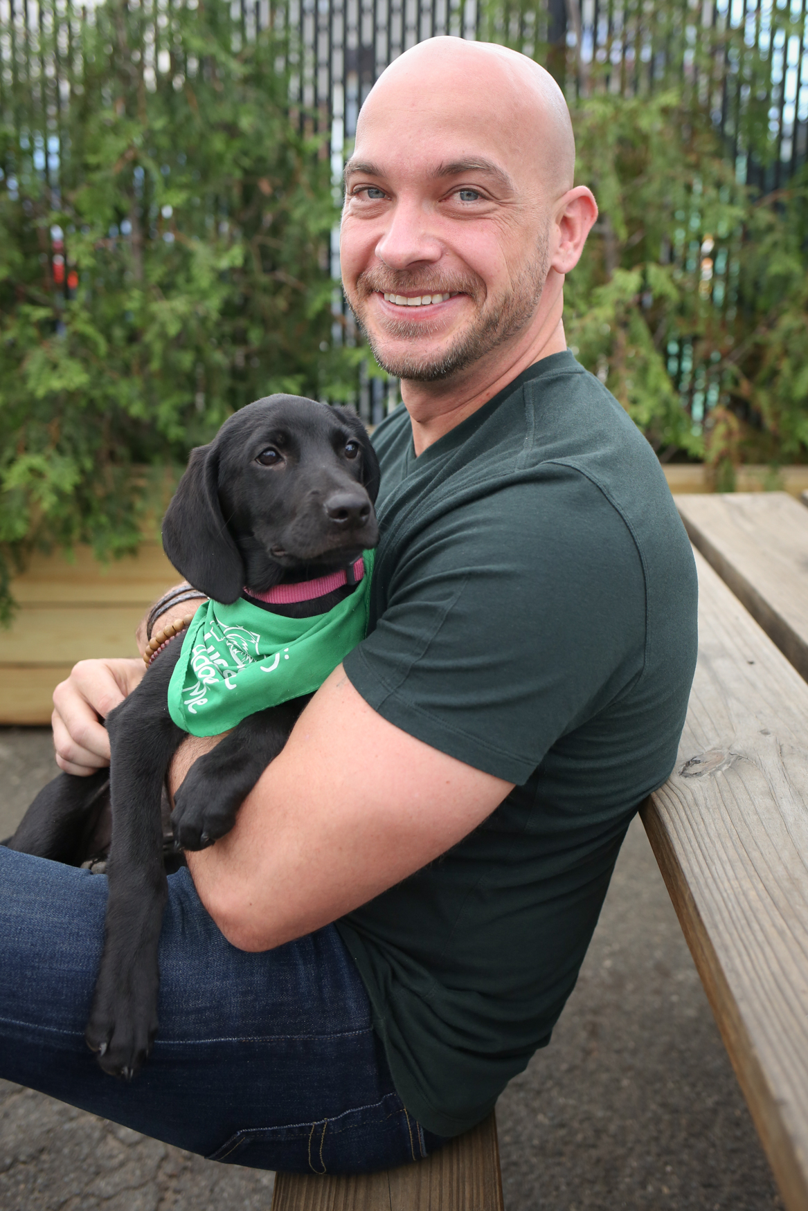 Meet Marshmallow and Aaron, a 3.5-month-old Black Lab/Shepherd mix and a 38-year-old human respectively. Photo location: Midlands Beer Garden (Image: Amanda Andrade-Rhoades/ DC Refined)
