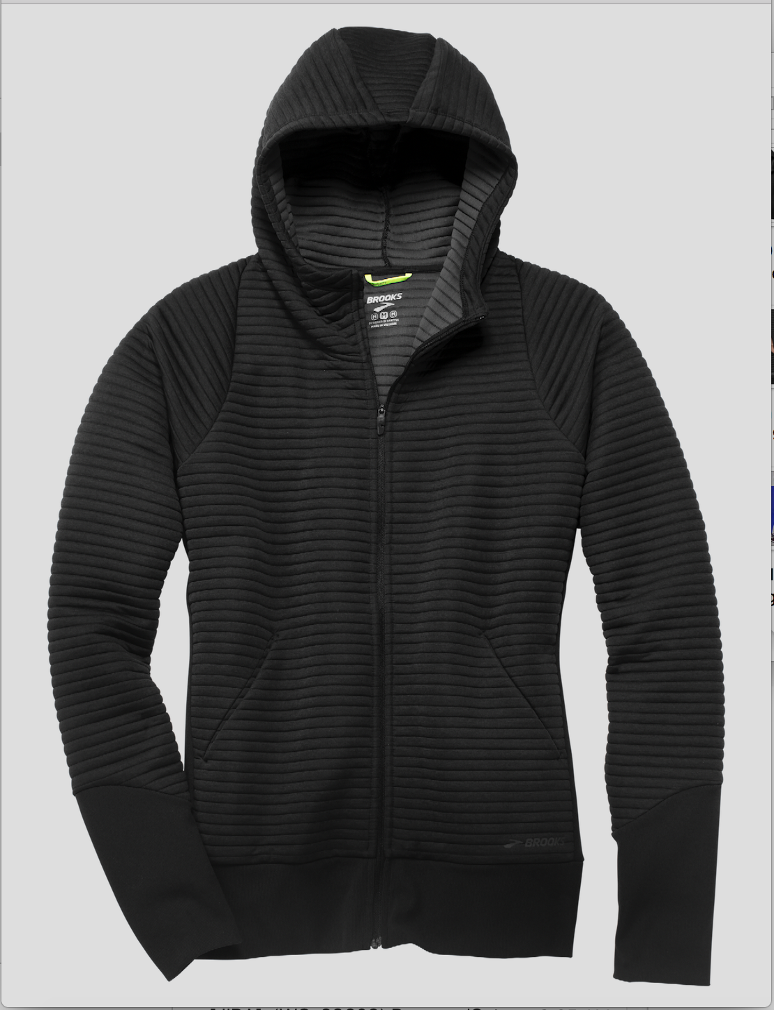 It's simple but pleated (to give it a little style), made with thermal fabric to continually keep you warm (but at the same time isn't bulky), has pockets (thank you thank you), and looks good on every single body type that I've seen in it so far. (Image: Brooks Running)