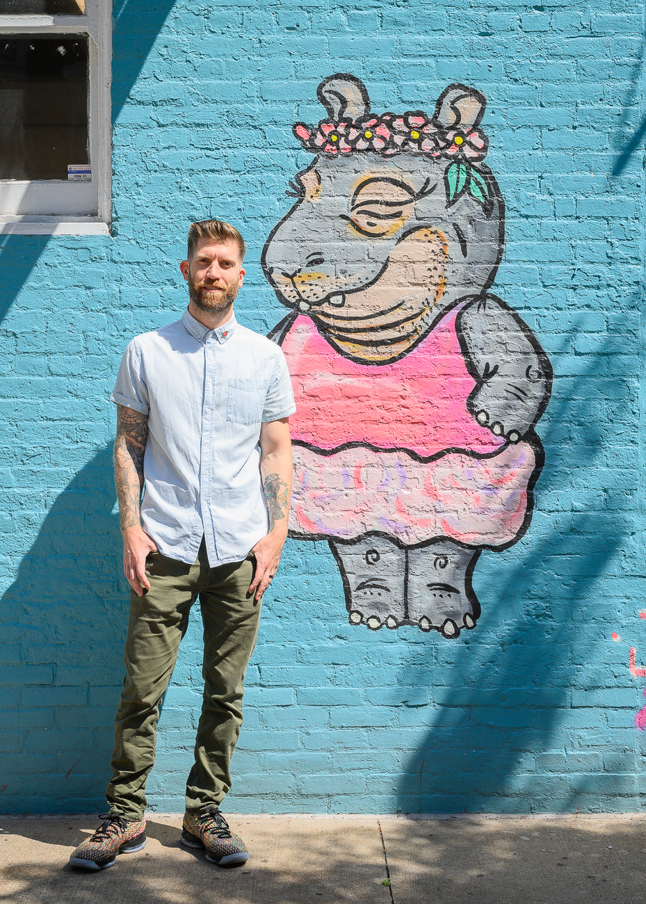 Josh Stout next to one of the three Fionas in his mural along 8th Street / Image: Phil Armstrong, Cincinnati Refined // Published: 8.10.19