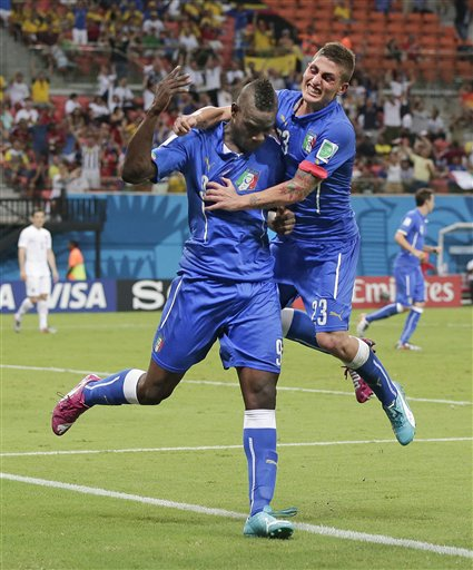 Italy's Mario Balotelli (9) celebrates with Italy's Marco Verratti (23) after Balotelli scored his side's second goal during the group D World Cup soccer match between England and Italy at the Arena da Amazonia in Manaus, Brazil, Saturday, June 14, 2014.
