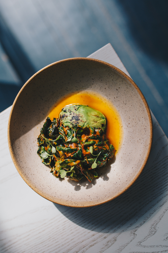 Course two: grilled avocado with toasted farro, pumpkin, and greens / Image: Catherine Viox // Published: 10.23.18