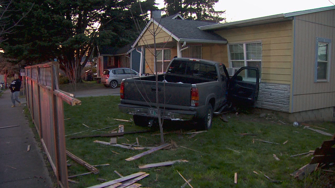 Witnesses say a truck smashed into six cars and then a house along Southeast Ash Street between 122nd and 119th Tuesday night, April 6, 2021. (KATU)