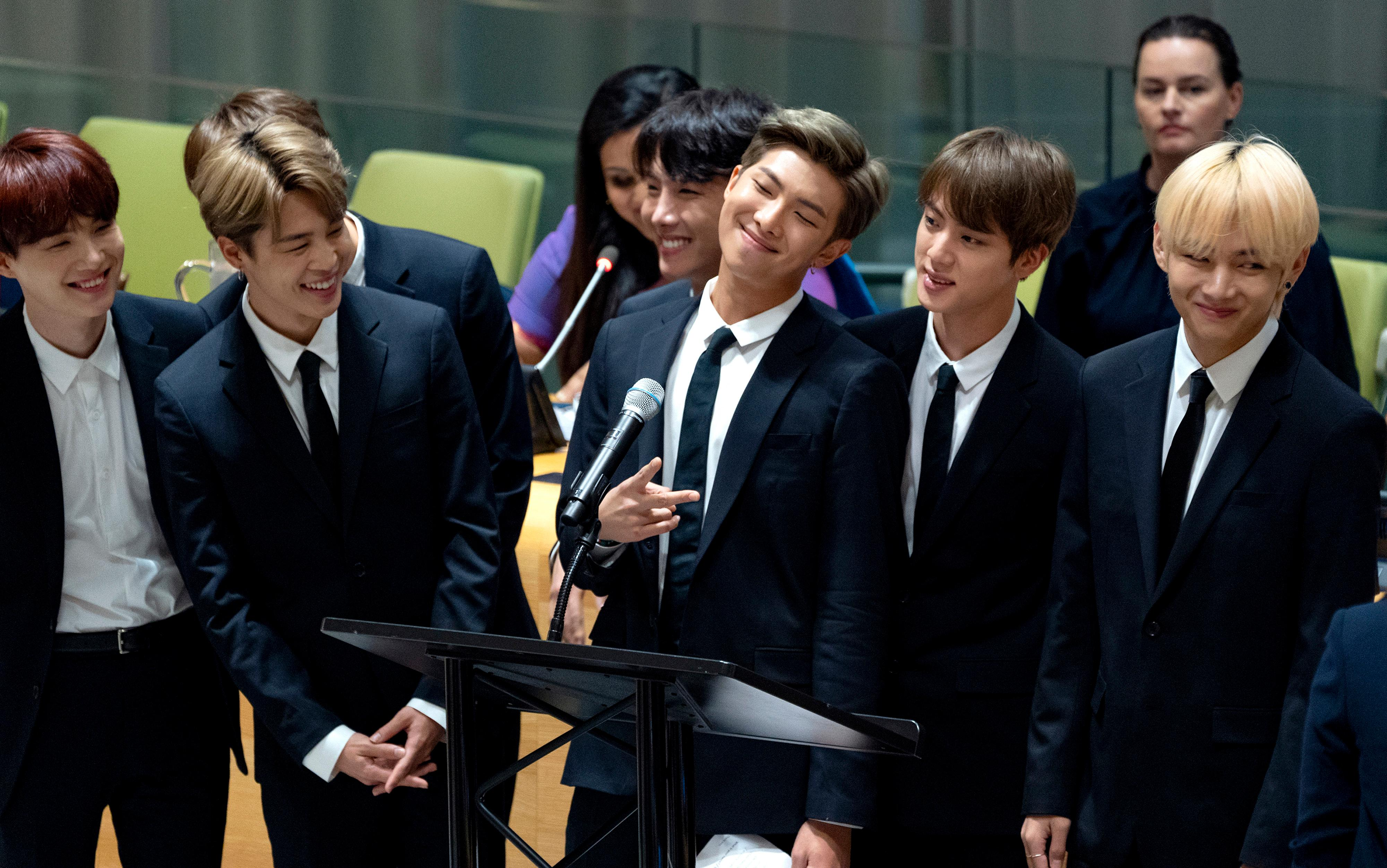 FILE- In this Sept. 24, 2018, file photo, members of the Korean K-Pop group BTS attend a meeting at the United Nations high level event regarding youth during the 73rd session of the United Nations General Assembly at U.N. headquarters. (AP Photo/Craig Ruttle, File)