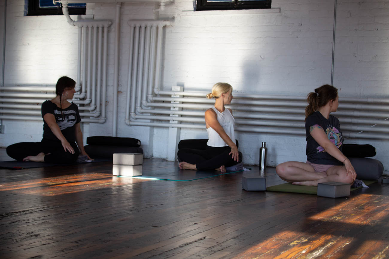 The space was once used as a bakery and ice creamery, so it initially wasn't in group-yoga-class condition. The floors were unusable and electricity was essentially nonexistent. / Image: Katie Robinson, Cincinnati Refined // Published: 9.30.19