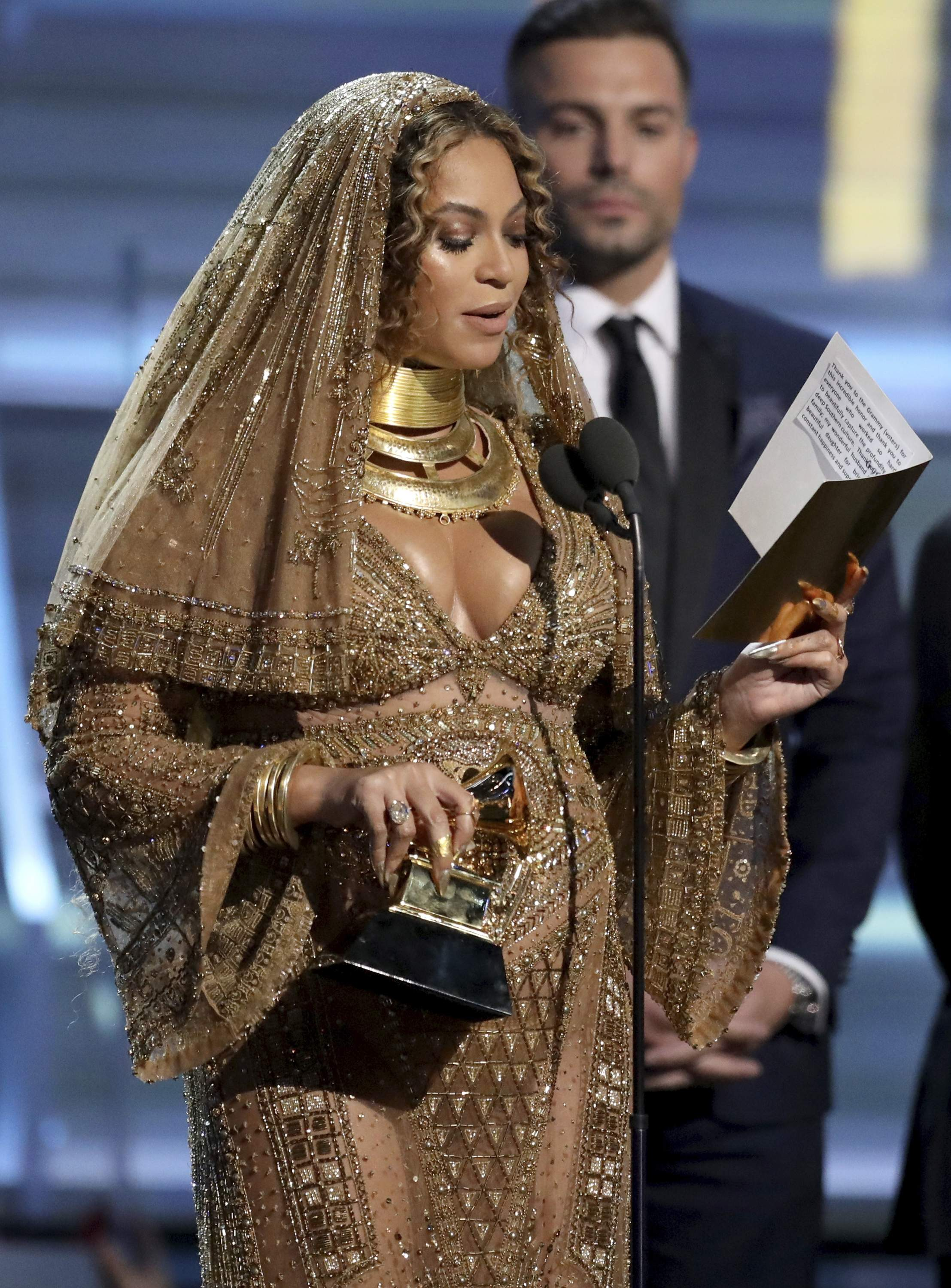 Beyonce accepts the award for best urban contemporary album for 'Lemonade' at the 59th annual Grammy Awards on Sunday, Feb. 12, 2017, in Los Angeles. THE ASSOCIATED PRESS