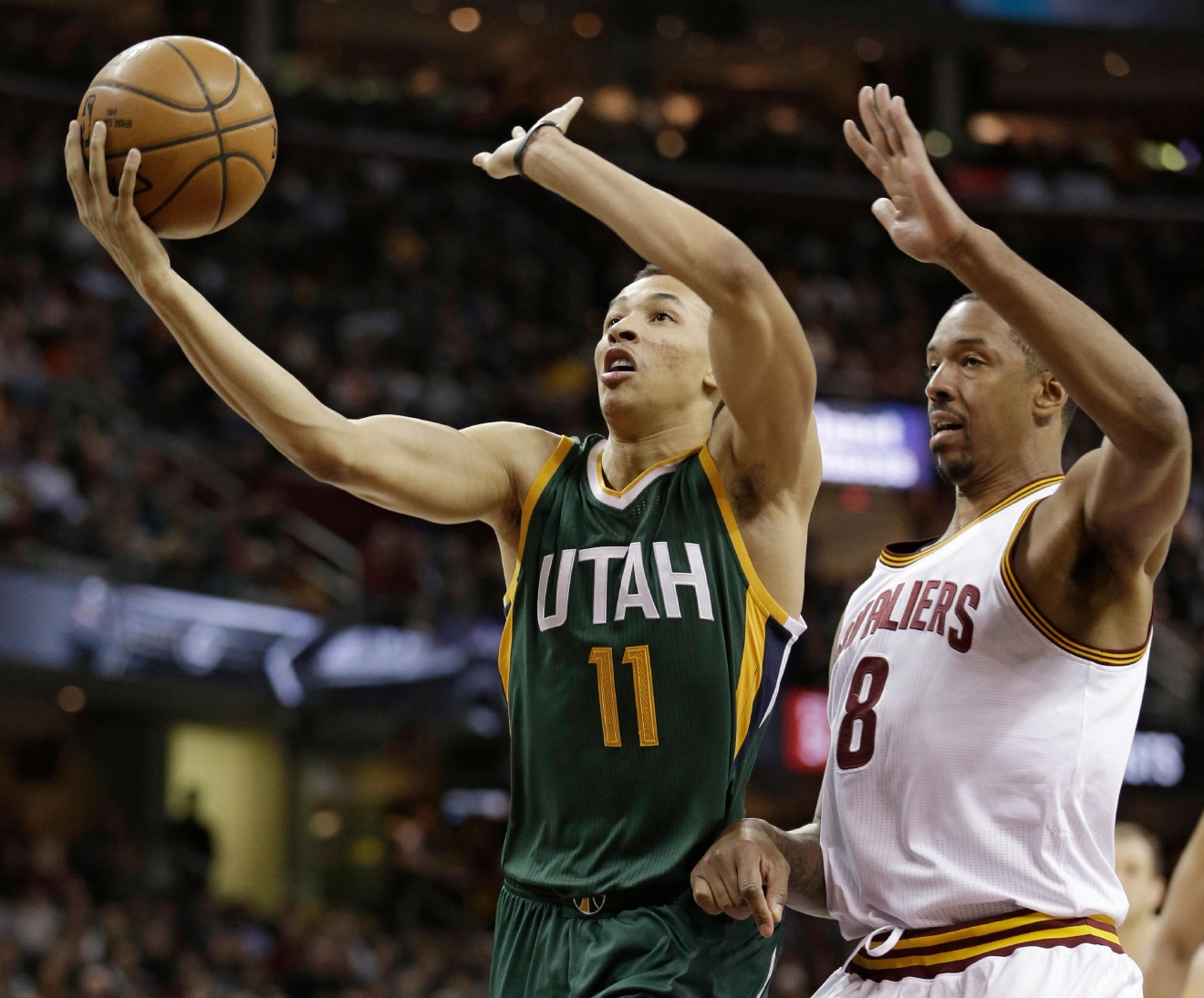 Utah Jazz's Dante Exum (11) drives against Cleveland Cavaliers' Channing Frye (8) in the first half of an NBA basketball game, Thursday, March 16, 2017, in Cleveland. (AP Photo/Tony Dejak)
